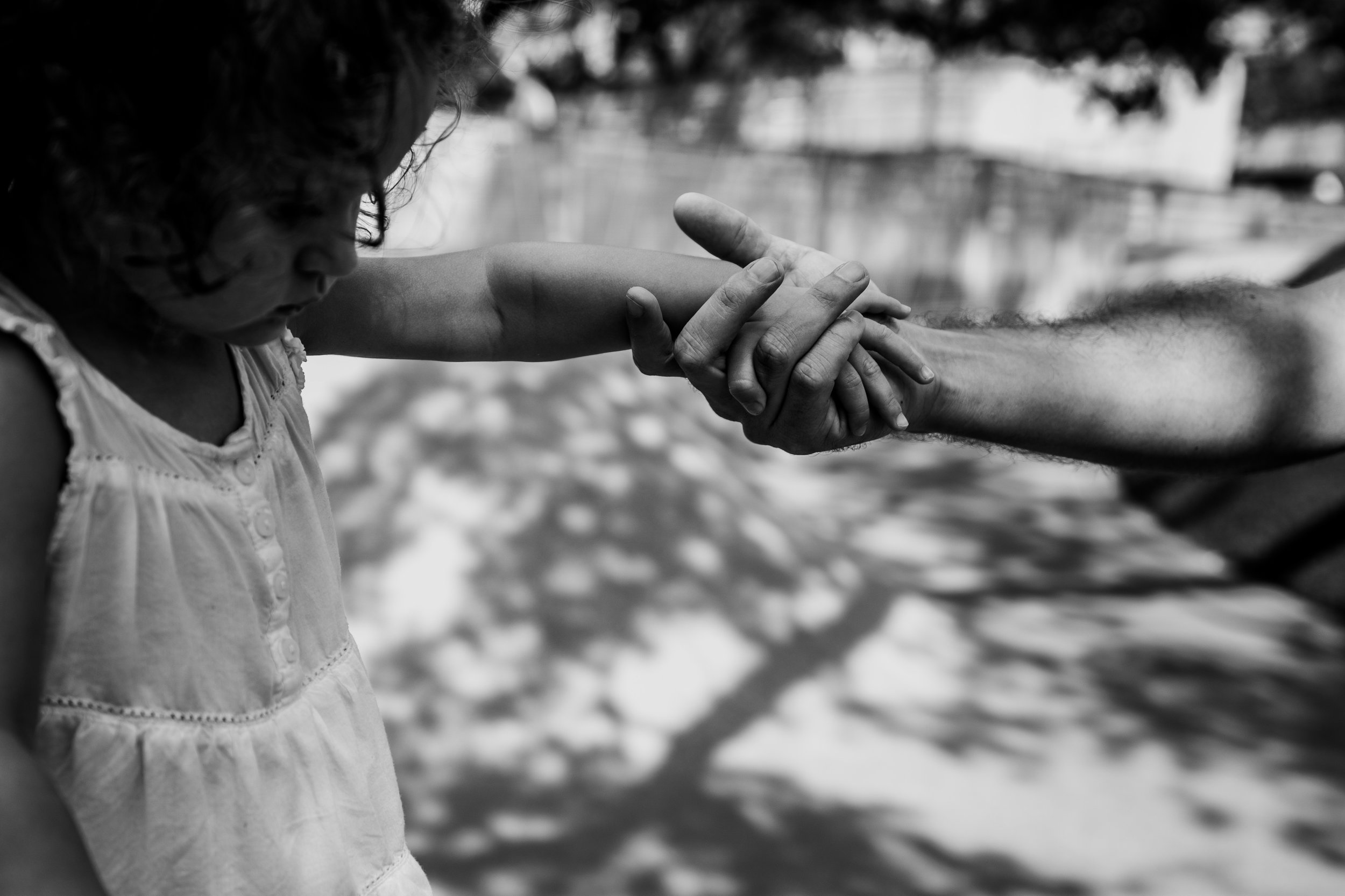 Daughter takes father's hand