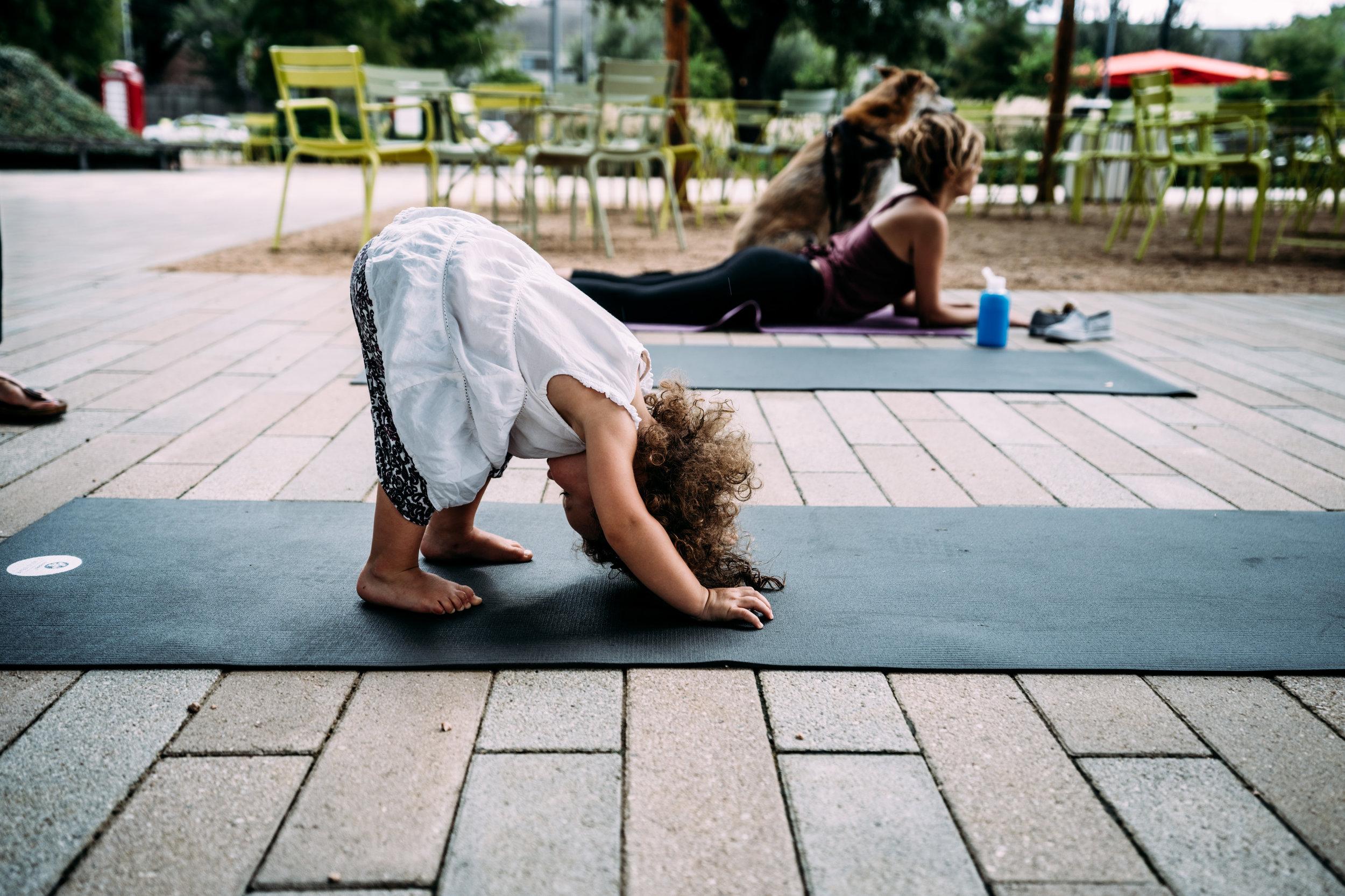 Little girl does yoga