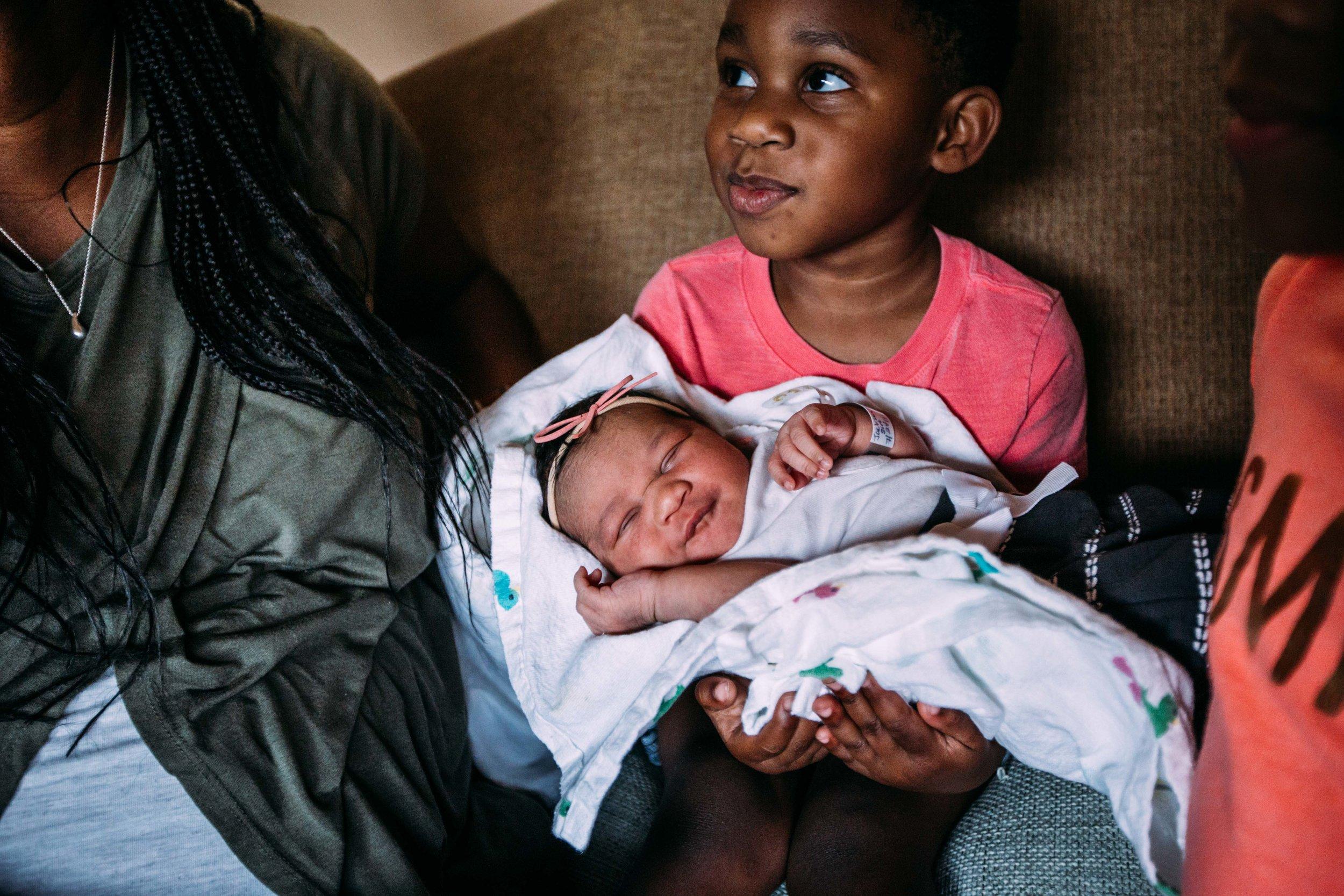 family brings home newborn.jpg