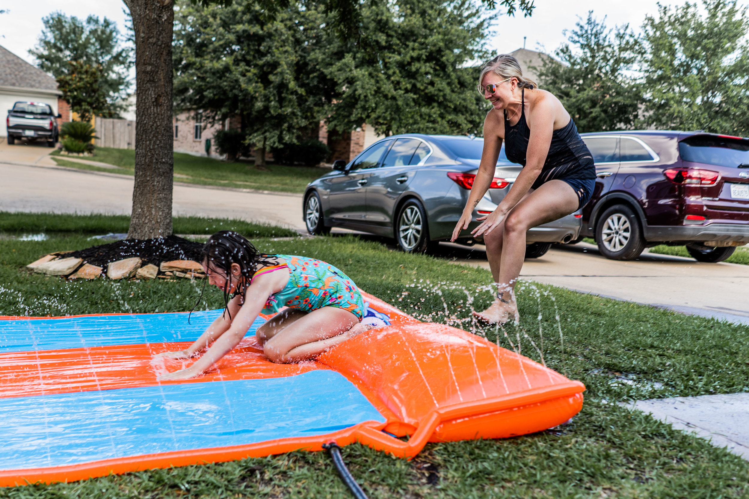 mother and daughter slip n slide-1.jpg