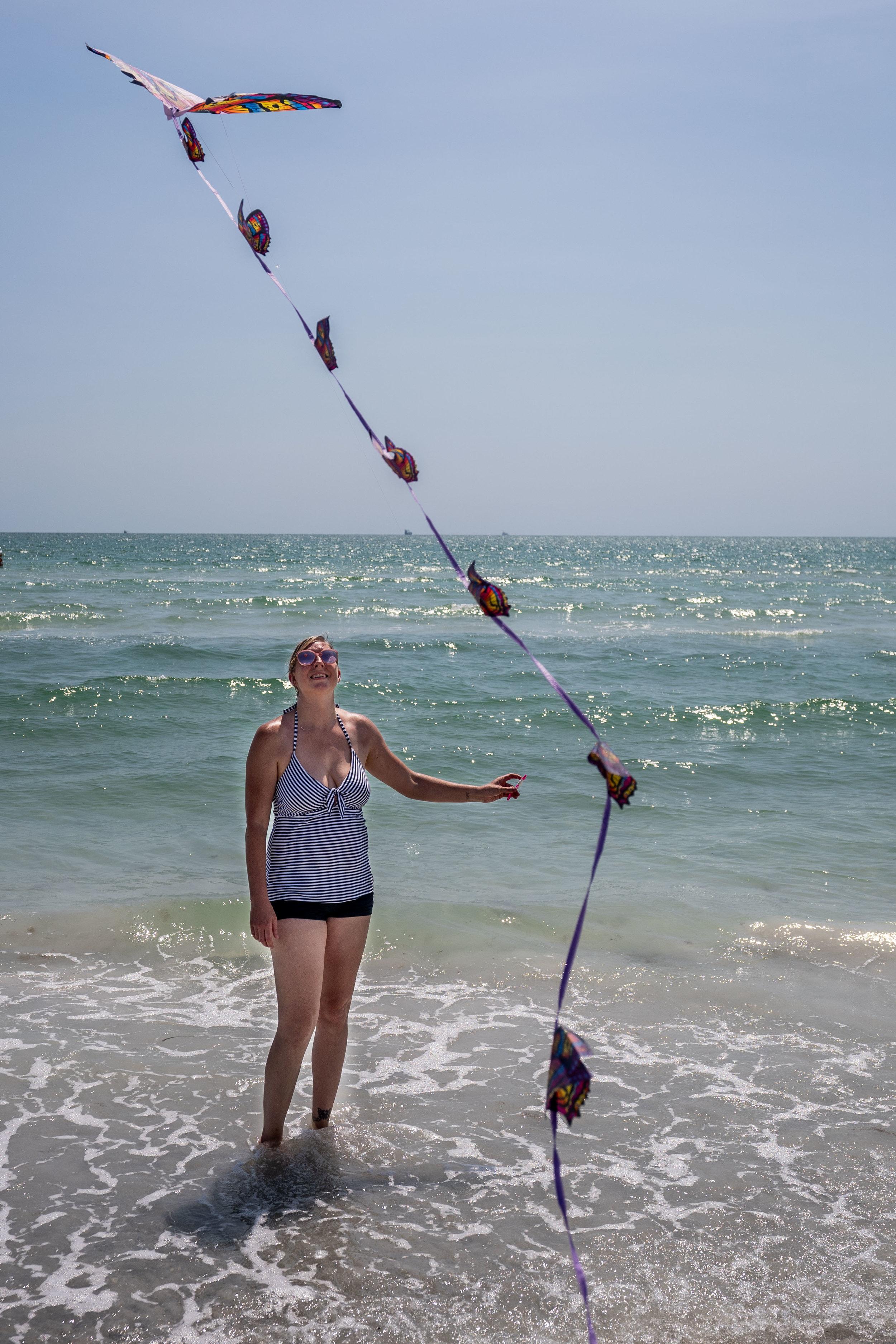 mom flying a kite at the beach-1.jpg