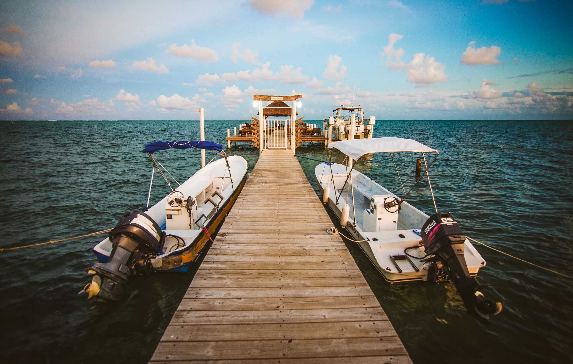 The sunset view from our dock in Caye Caulker. On taht horizon is the Belize Barrier Reef.
