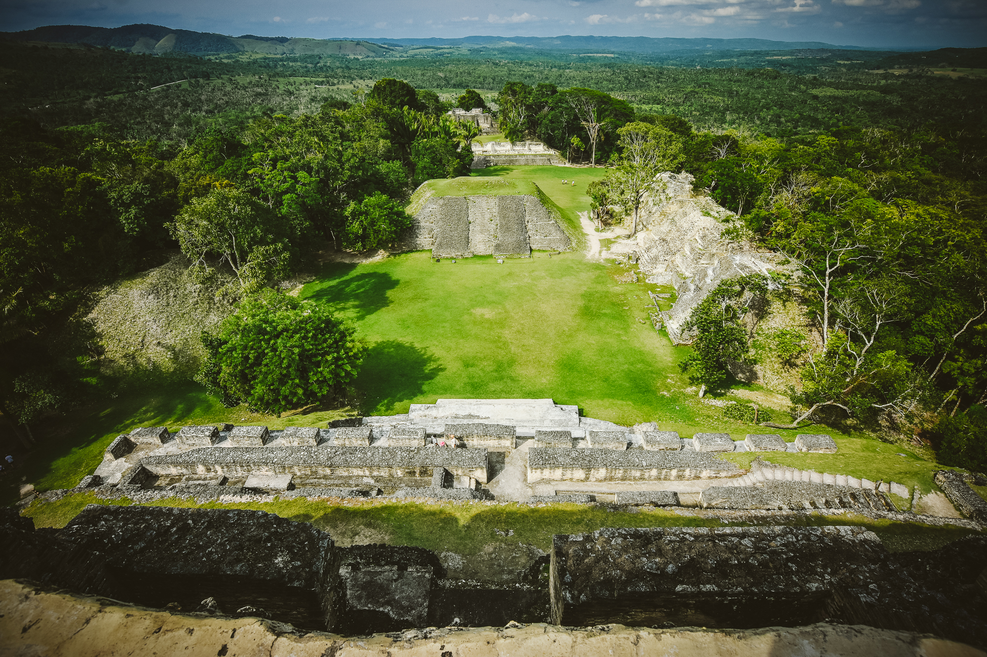 The fantastic view from atop the main temple at  Xunantunich , one of the tallest and most interesting ancient Mayan structures still in existence. To the west (left) is Guatemala. Getting up here was the easy part...
