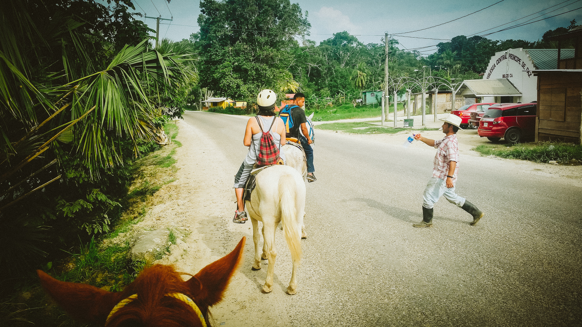 In the small village of San Jose Succotz, our guide from  Hanna Stables  got a quick refreshment from a friend after crossing the Mopan River on pulley ferry. My horse, Justice, did it like the pro he is!