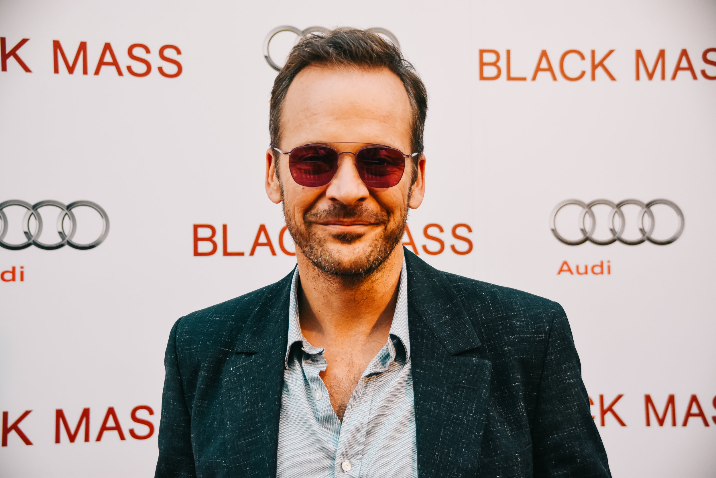 Peter Sarsgaard stops for a minute before the  Black Mass  party.