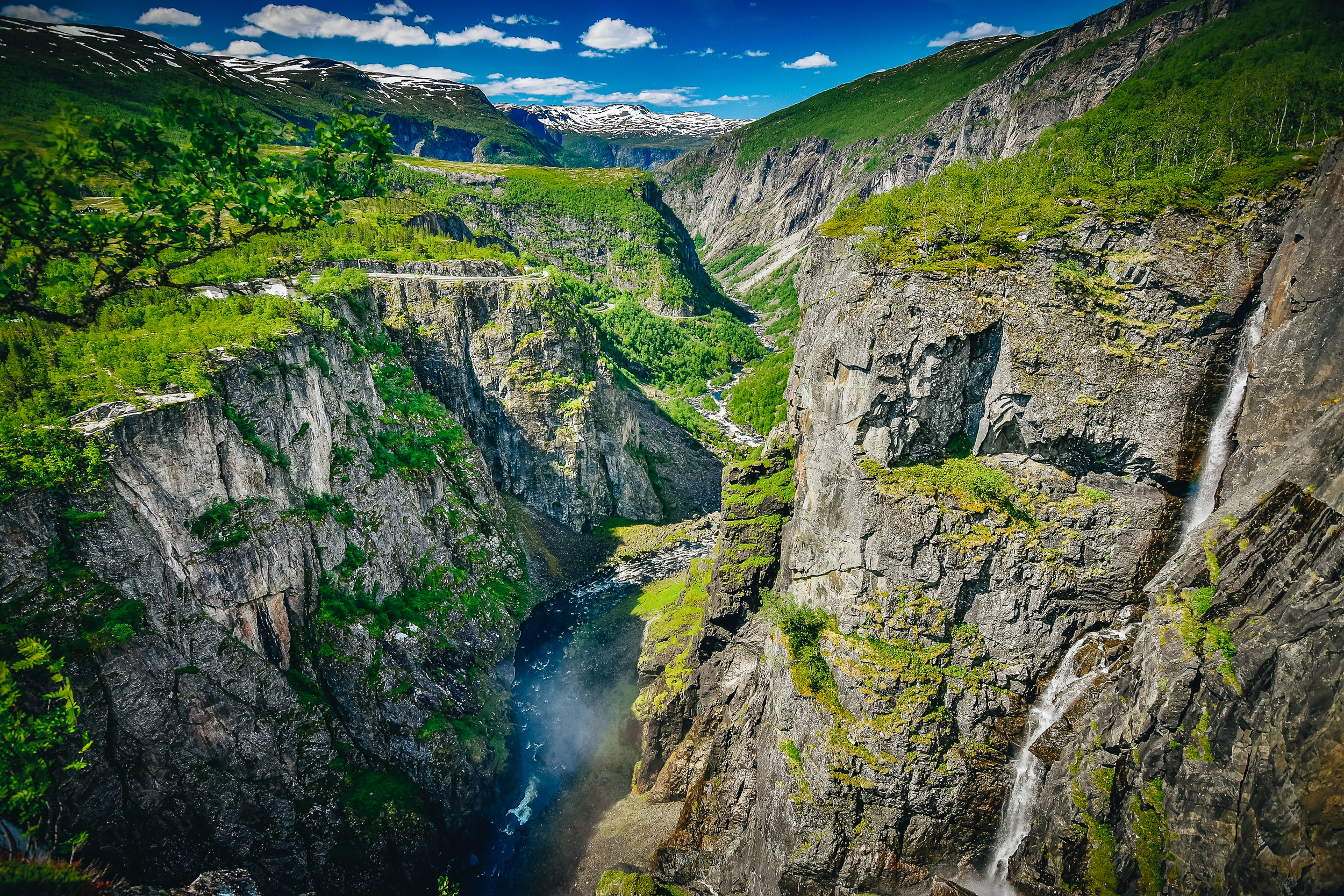 "Nestled in the Måbødalen valley is the dammed Fossili waterfall (""foss"" meaning ""waterfall"" in Norwegian). Shooting a dark canyon at high noon near the Arctic in summer is tricky but nothing tha a little HDR can't handle. ;)"