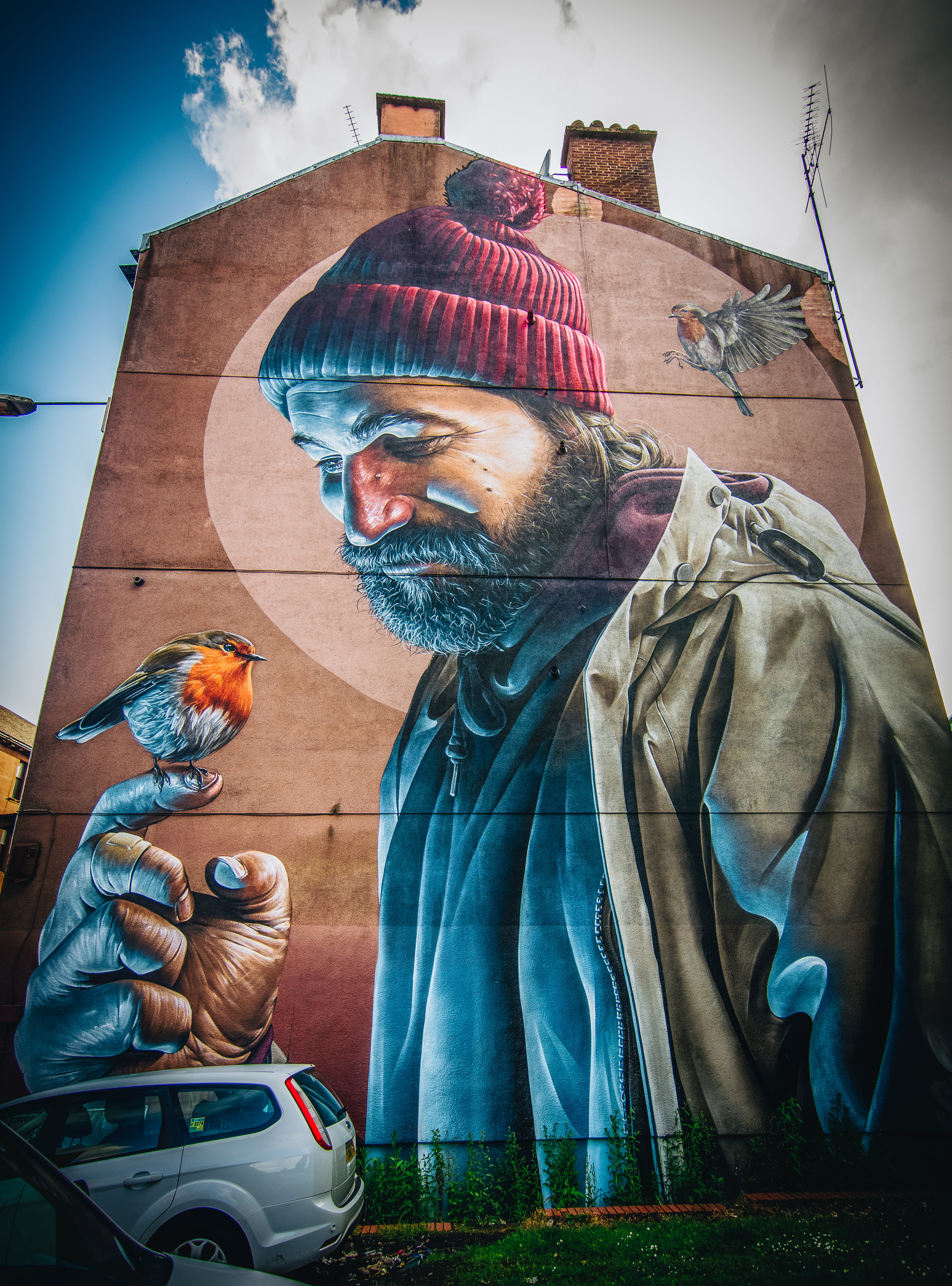 This is one of my favourite pieces of street art. St. Mungo is Glasgow's patron saint and is pictured here as he would likely look today, homeless and caring for robins. ( Read more here .)