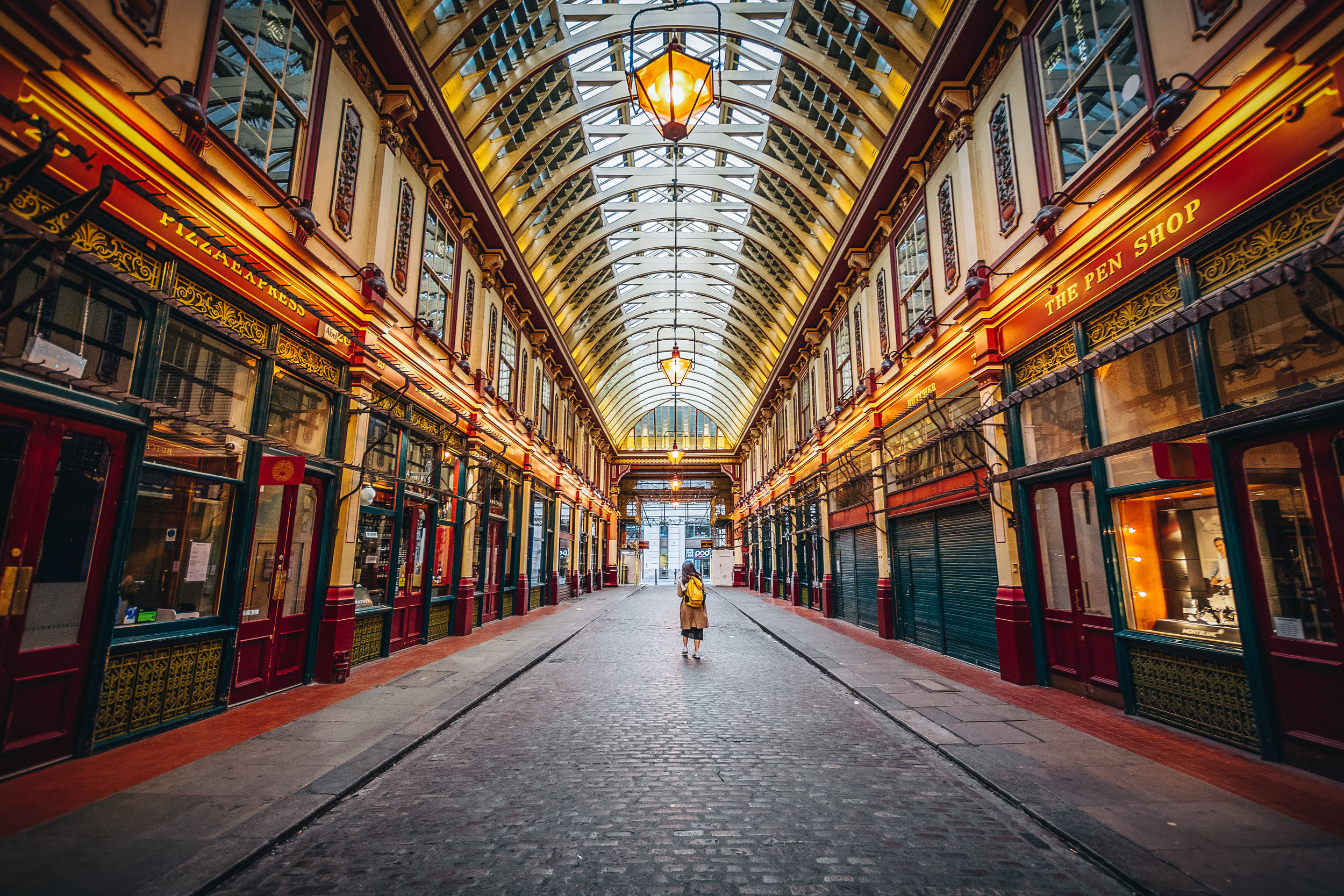 In my habit of ending up in places after they've closed, here is Leadenhall Market with a single tourist wandering the halls.