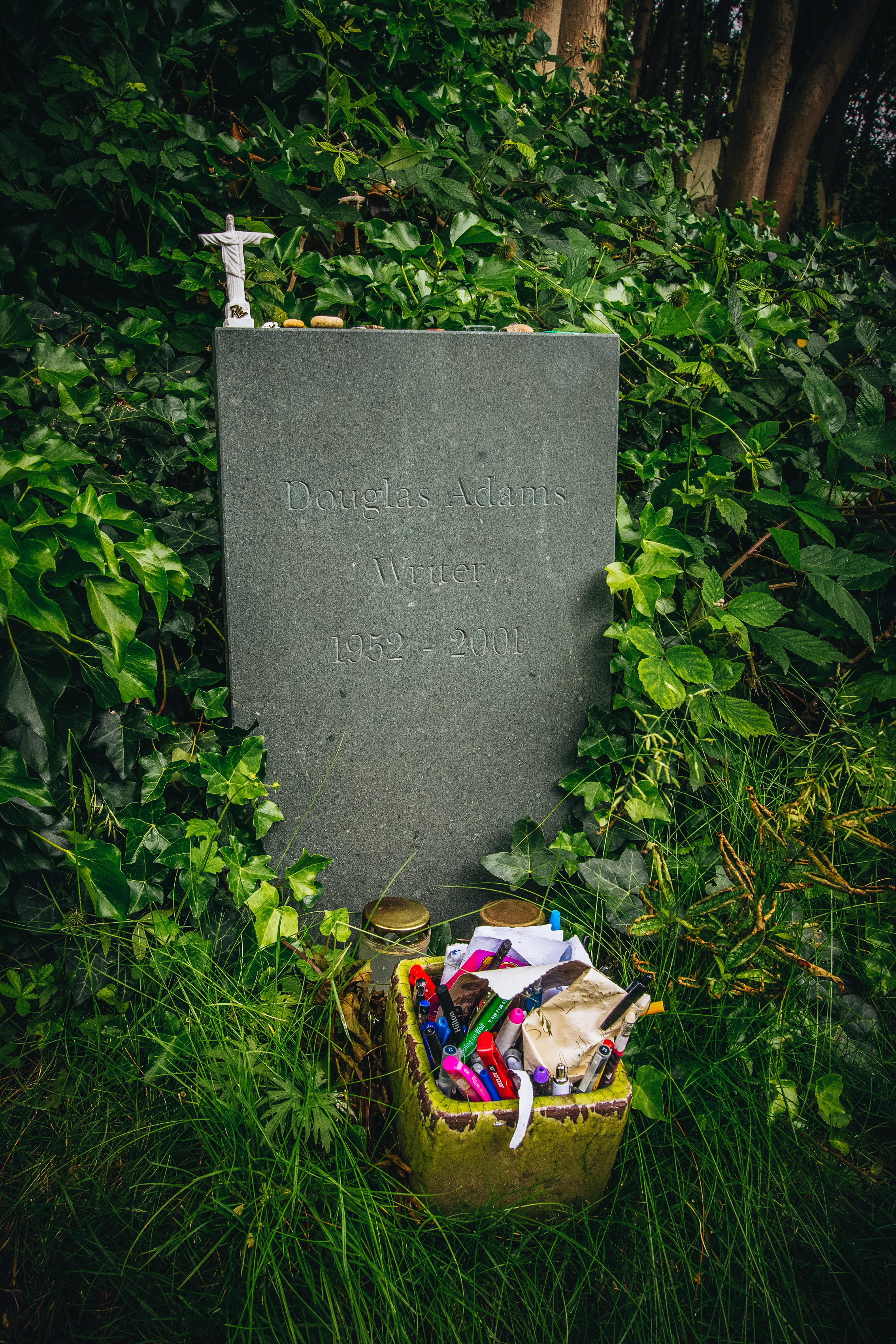 The gravestone of author Douglas Adams. There were a lot of people buried in Highgate (like Marx) but this one was neat with the people leaving pens.