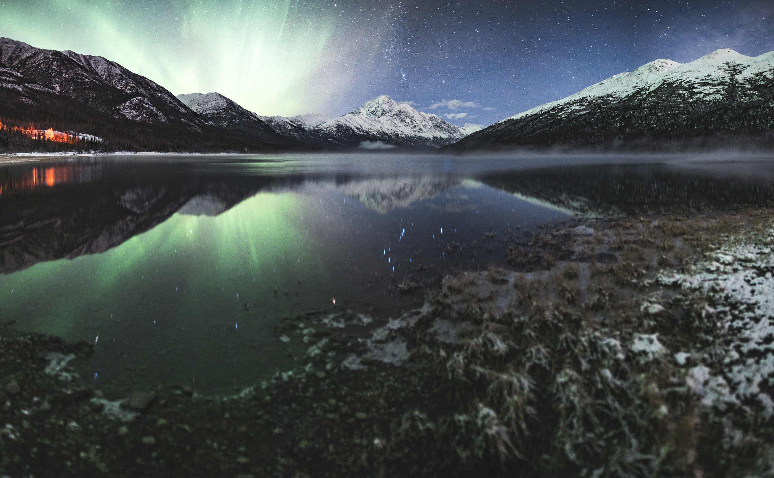This is a panorama stitch of 32 images from Eklutna Lake in Alaska. Each image was shot at a focal length of 24mm, f/1.4, 8.0 seconds, and an ISO of 320. The images were then stitched together using Adobe Lightroom.