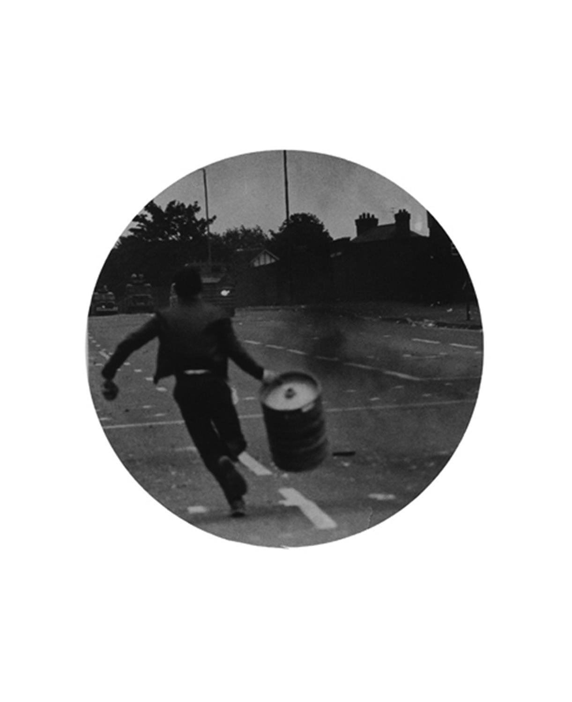 Untitled (Boy running with barrel)