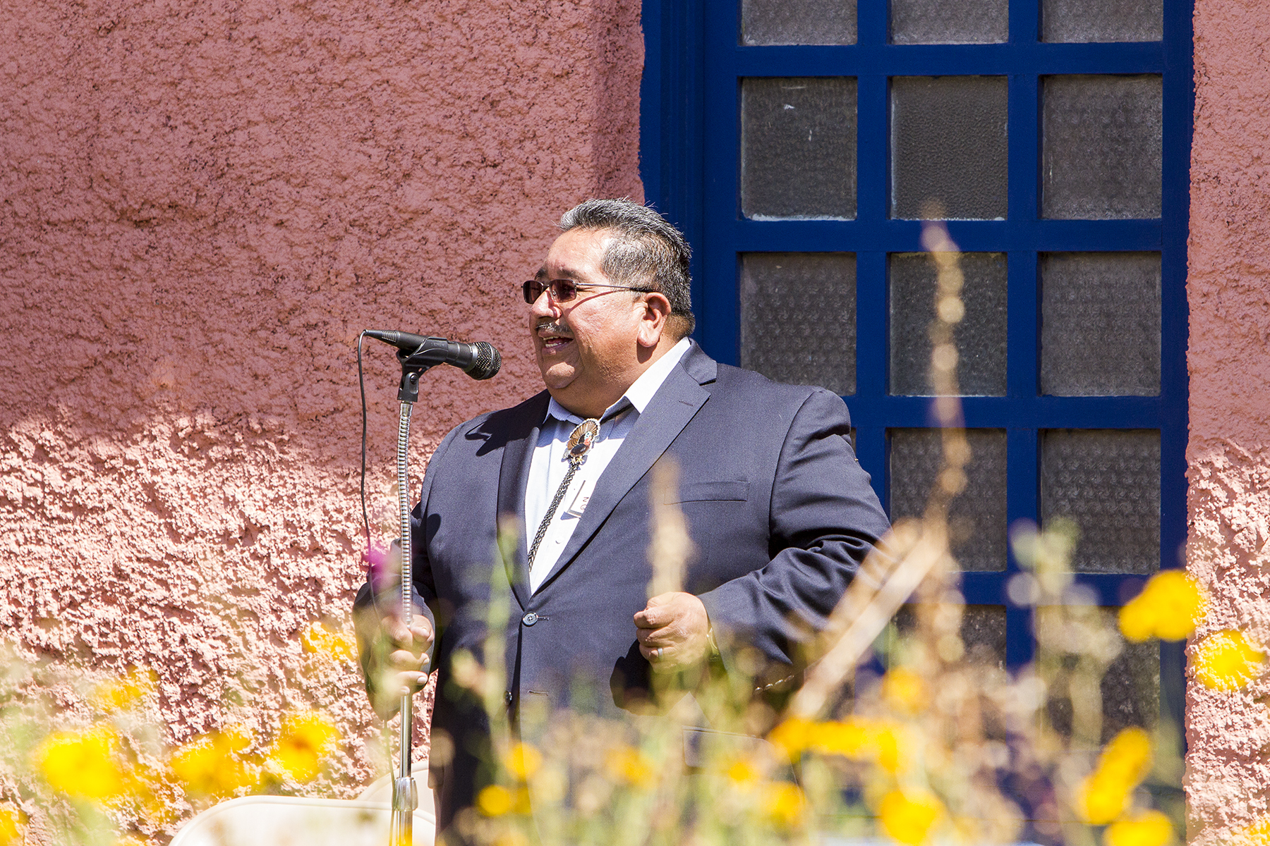 Zuni Pueblo Governor Val Panteah addressing the crowd in the courtyard.