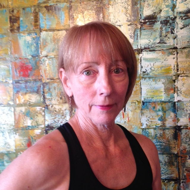 """COLLEEN CARLTON - """"In June 2015 I was about to retire from my long career in the UCLA Library system. First on my post-retirement list was to find a local yoga studio. A few months earlier I had read an article about Shannon and The Yoga Roots in the AV Press. Mmmm, this sounds great… I'll have to check them out!Three years later, here we are and I am so happy to have found TYR!I was a true novice when I arrived, but Shannon immediately put me at ease and all the instructors have been supportive and encouraging. For me personally, yoga has improved both my mental and physical well-being. As my breathing technique improved, stress levels went down and I became less """"reactive"""" to the bumps and obstacles in everyday life.Starting with slow flow and then moving up to heated power flow, I am stronger and more flexible than I could ever have imagined on Day One. The practice definitely helps to reduce the pain of arthritis in my hip, and my confidence grows with each successful inversion move. And of course, being among classmates inspires me to try harder and smile with each crazy new move you all push my way. Any day in yoga class is a good day!"""""""