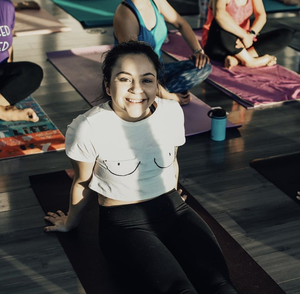 """GABRIELA FELIX - """"I found The Yoga Roots years ago just looking for a healthy escape over a short winter break from school. Sadly that break had to end and I wasn't able to return to The Yoga Roots until recently. When I came back I was ready to invest myself fully in this practice. I was so happy to be able to come back to The Yoga Roots where they welcome everyone with open arms. It's always a pleasure to go to yoga because the second you walk in you can feel a sense of relief and the uplifting positive energy surrounding the room. I'm constantly trying to get my friends and family to come to The Yoga roots because I want them to be able to experience such a fun-loving environment with me.Yoga is where I release the unnecessary and find what I need. Practicing has helped me shape the way I perceive life all around me in a positive way. Participating in the 30 day yoga challenge taught me that there's never a bad time for yoga. If you're sad, tired, happy, you name it yoga will make you feel a million times better.Thank you Shannon for all your motivational """"what if's."""" To all the teachers, you continue to inspire me. I look forward to continuing my yoga journey with The Yoga Roots by my side."""""""