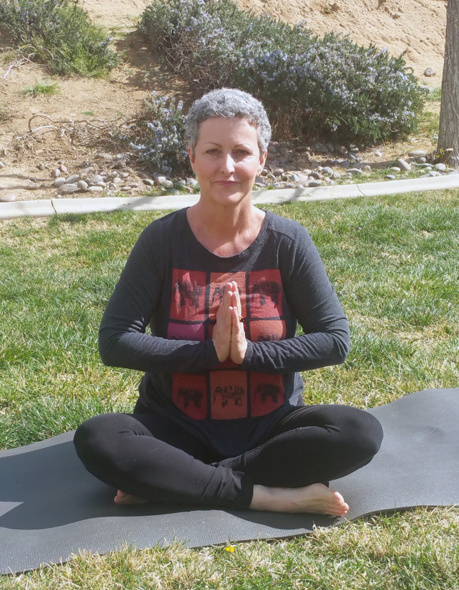 """MEG KELLY - """"I have practiced yoga intermittently over the last 36 years, but most devotedly in the last four after being diagnosed with metastatic cancer. Shannon and crew have been very supportive, loving and kind during this most challenging time of my life. Yoga has helped me develop roots, choose peace and contentment and to live in """"today"""" without worrying too much about tomorrow. As my body has changed with cancer and treatment, so has my yoga practice. To be in a warm place that encourages me to listen to my body, accept where it is and love it without judgment has contributed greatly to my healing journey. I'm here today. Life is GOOD. Thanks, Shannon!"""""""