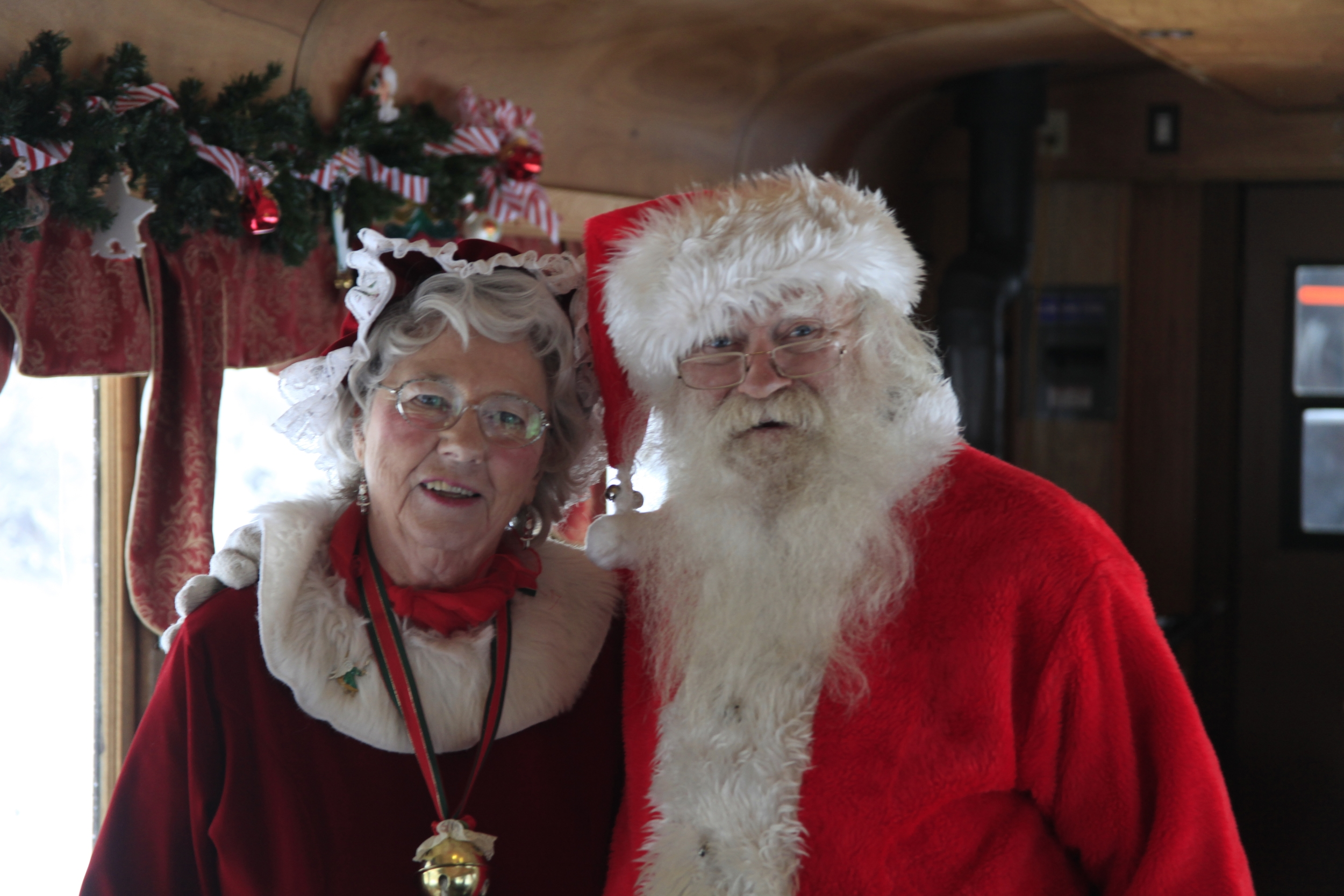 Santa and Mrs. Claus Aboard the Parlor Car Tour during Santa's North Pole adventure, an amazing train ride offered at the Georgetown Loop Railroad throughout the holiday season.