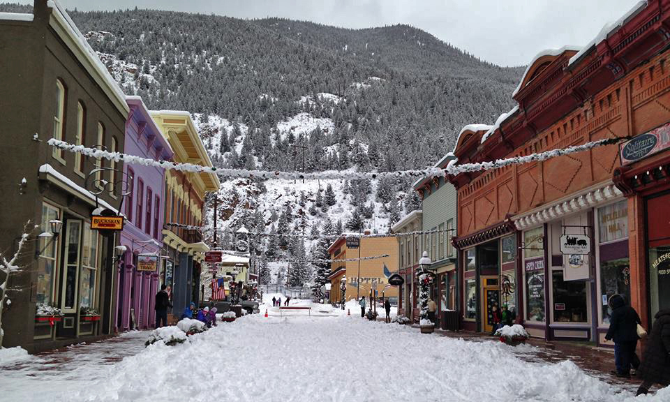 This photo shows downtown Georgetown in winter. Snow covers 6th Street and sits pretty on the garland strung from one side of the street to the other. Photo taken by Natalie Strom.
