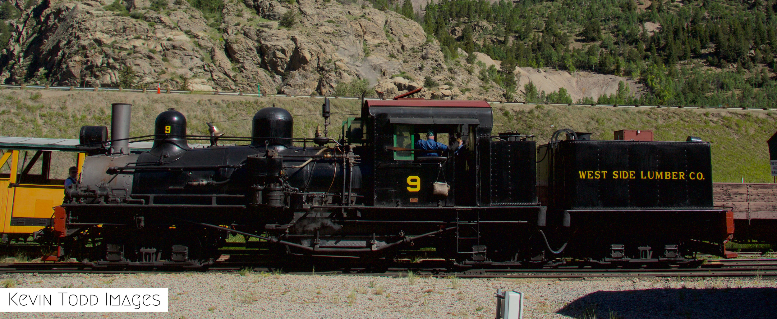 Photograph of a side shot of the shay number nine diesel engine featuring the number nine on the side as well as an original car which says West Side Lumber Company on the side. The shay operates at the Georgetown Loop Railroad on almost a daily basis. The historic engine lets off steam from its stack in the front of the engine and has a grand whistle that can be heard throughout the town.