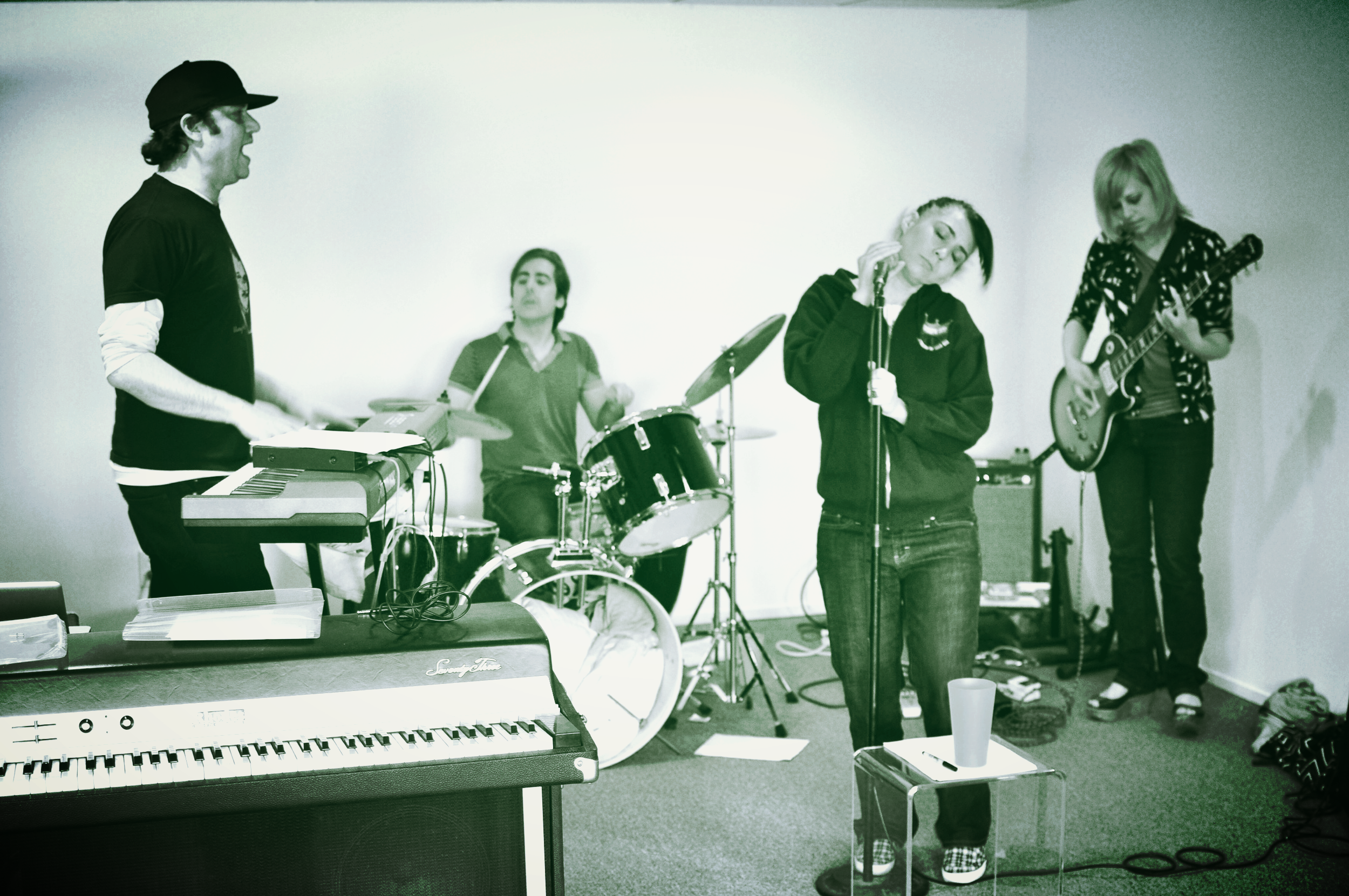 Rehearsing in Kathleen's basement before Kathi Wilcox moved to NYC.