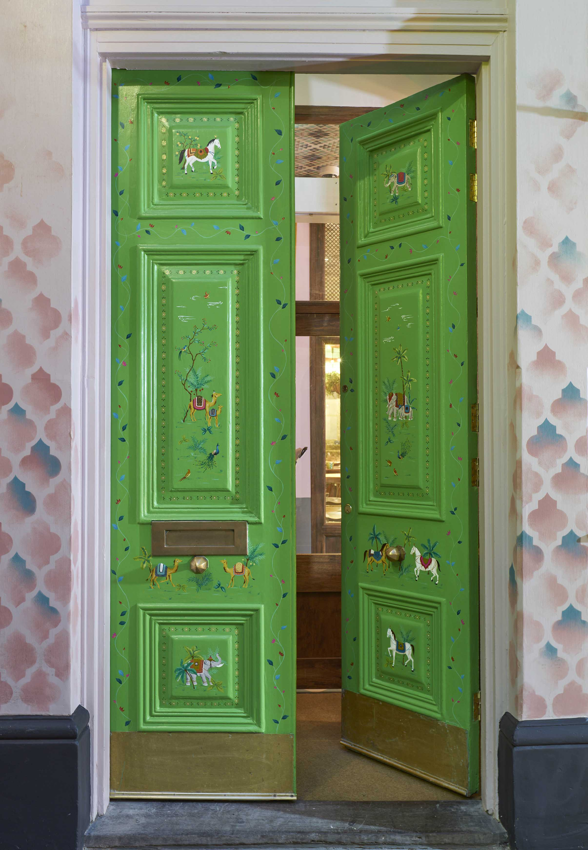 Entrance doors hand-painted with animal scenes and decorative borders.