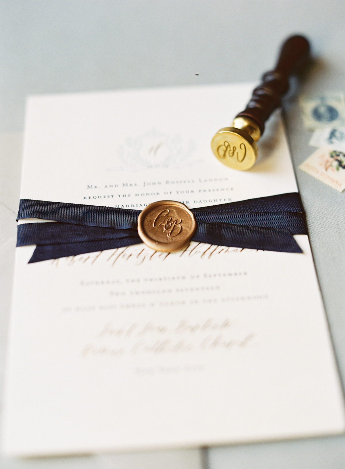 Plaza wedding invitation suite with navy ribbon and gold wax seal