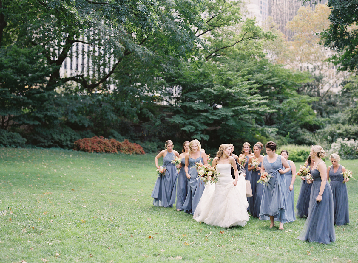 Bride and bridesmaids in dusty blue at Plaza wedding