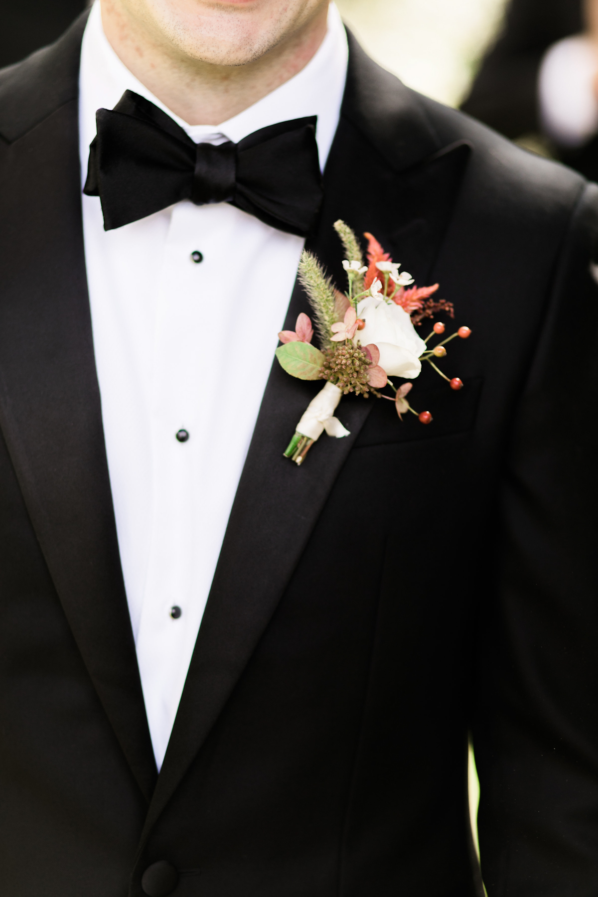 Black tuxedo and boutonniere for Plaza wedding