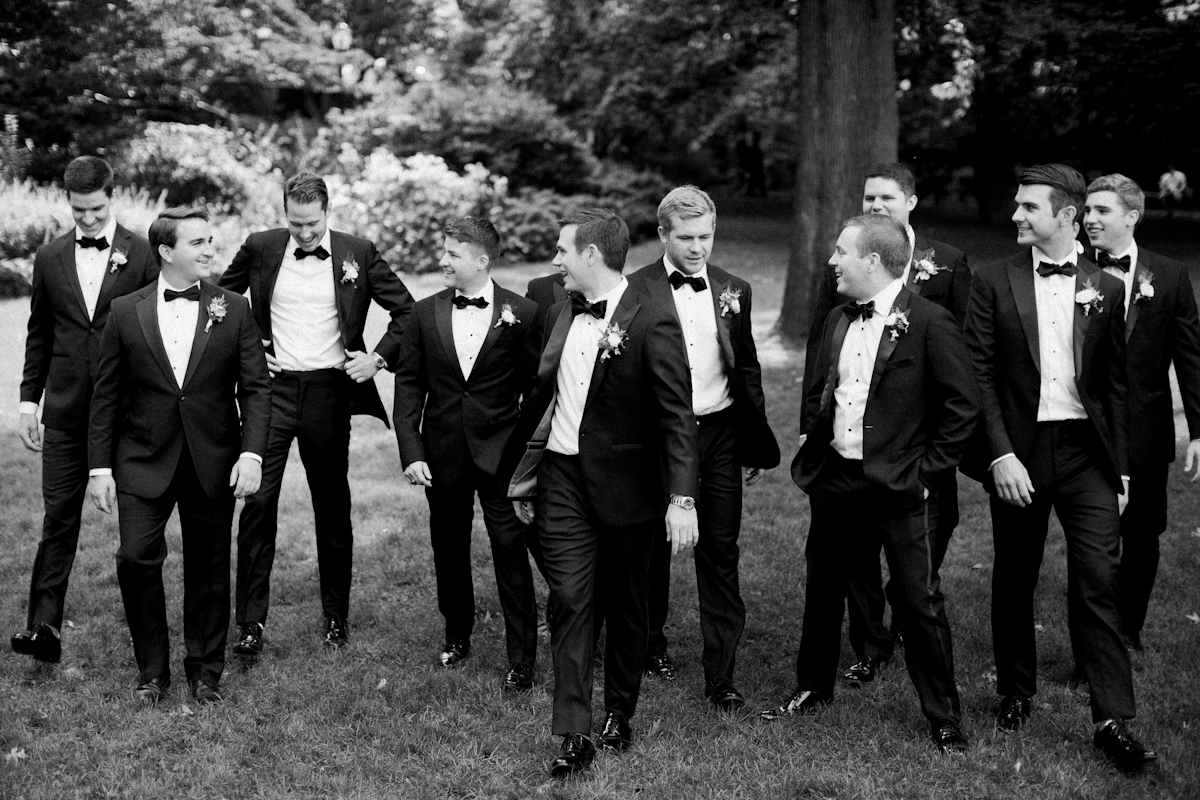 Groom and groomsmen in tuxedos at Plaza wedding
