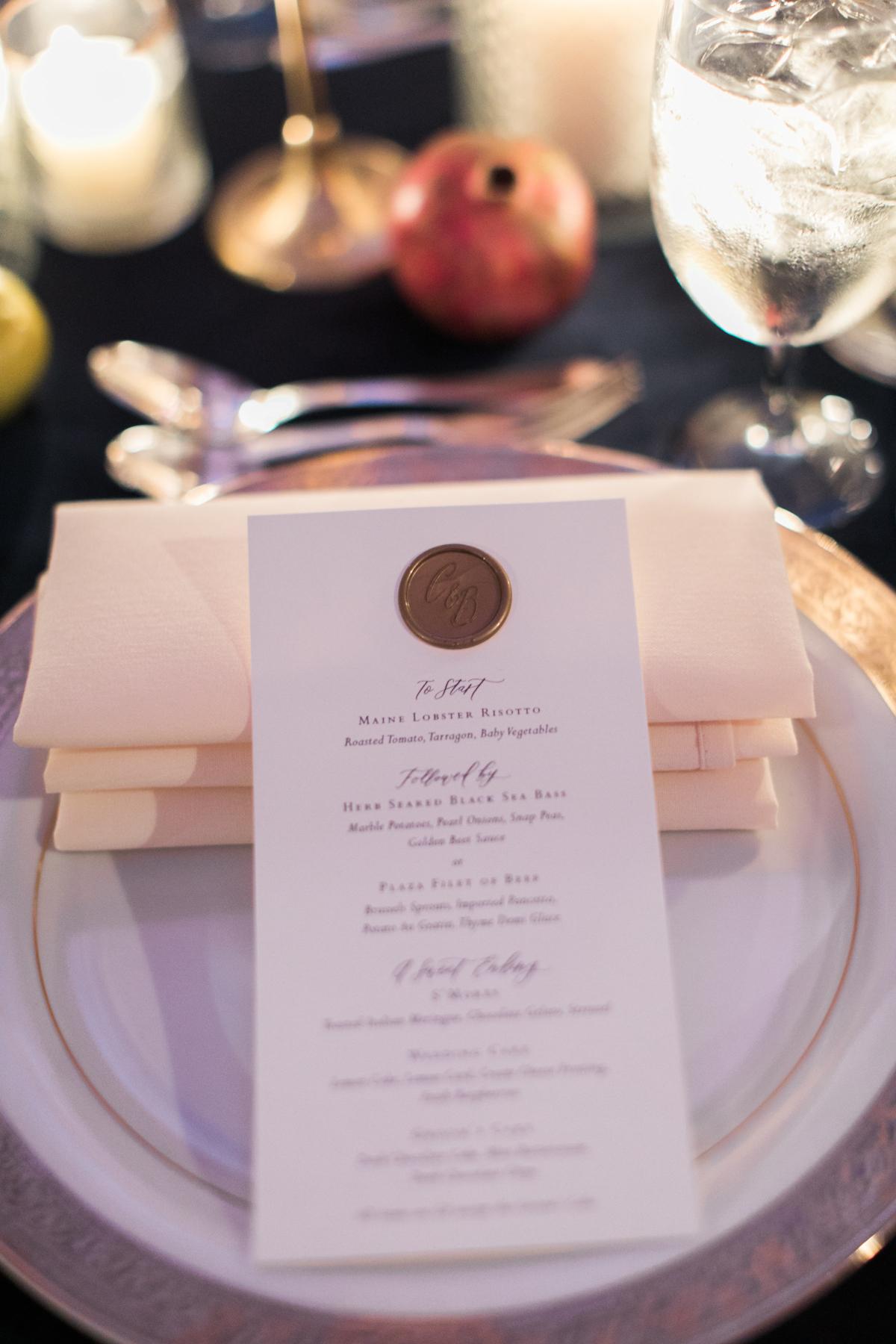 Plaza wedding menu with gold wax seal