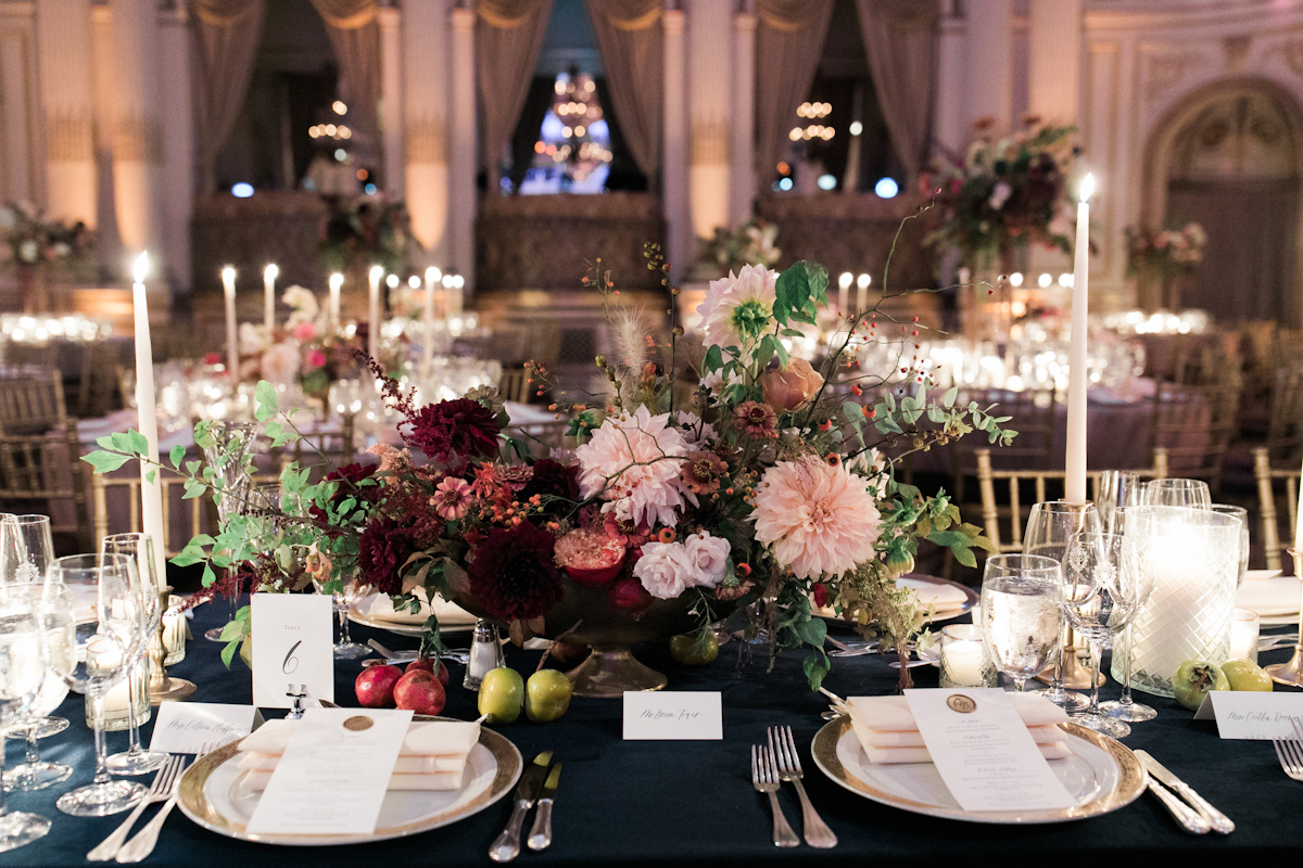 Plaza wedding flower centerpieces and taper candles