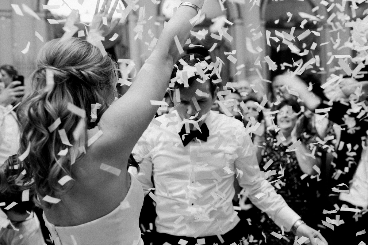 Bride and groom dancing in confetti at Plaza wedding