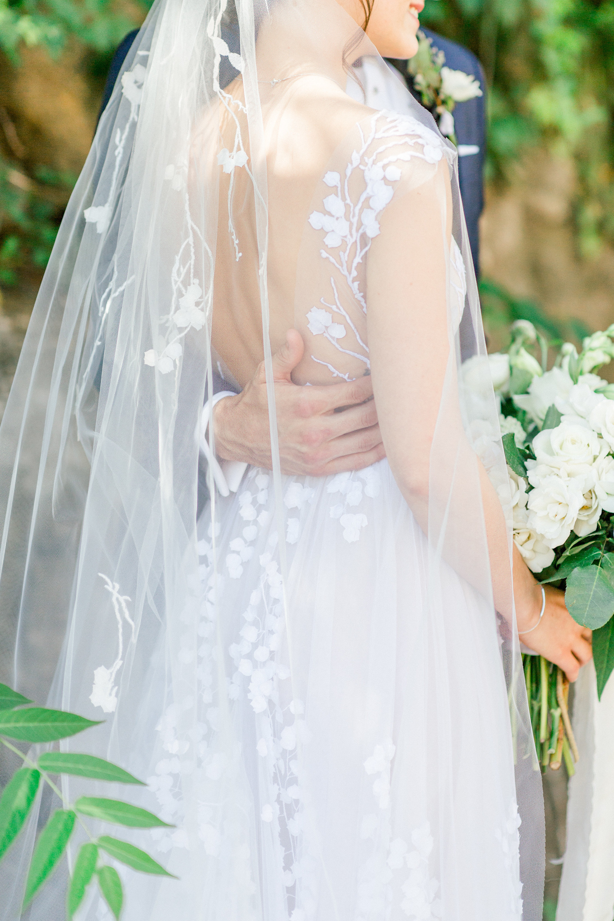 Bride in elegant gown with veil at Blue Hill at Stone Barns wedding
