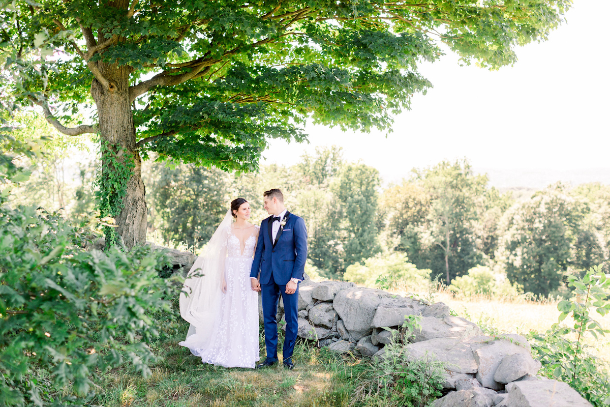 Bride and groom in front of a tree at Blue Hill at Stone Barns