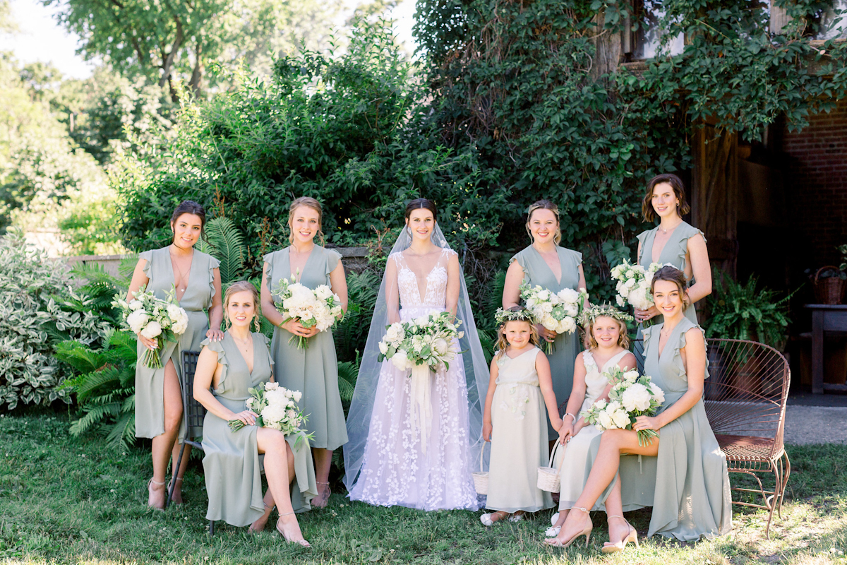 Bride, bridesmaids in sage green and flower girls at Blue Hill at Stone Barns wedding