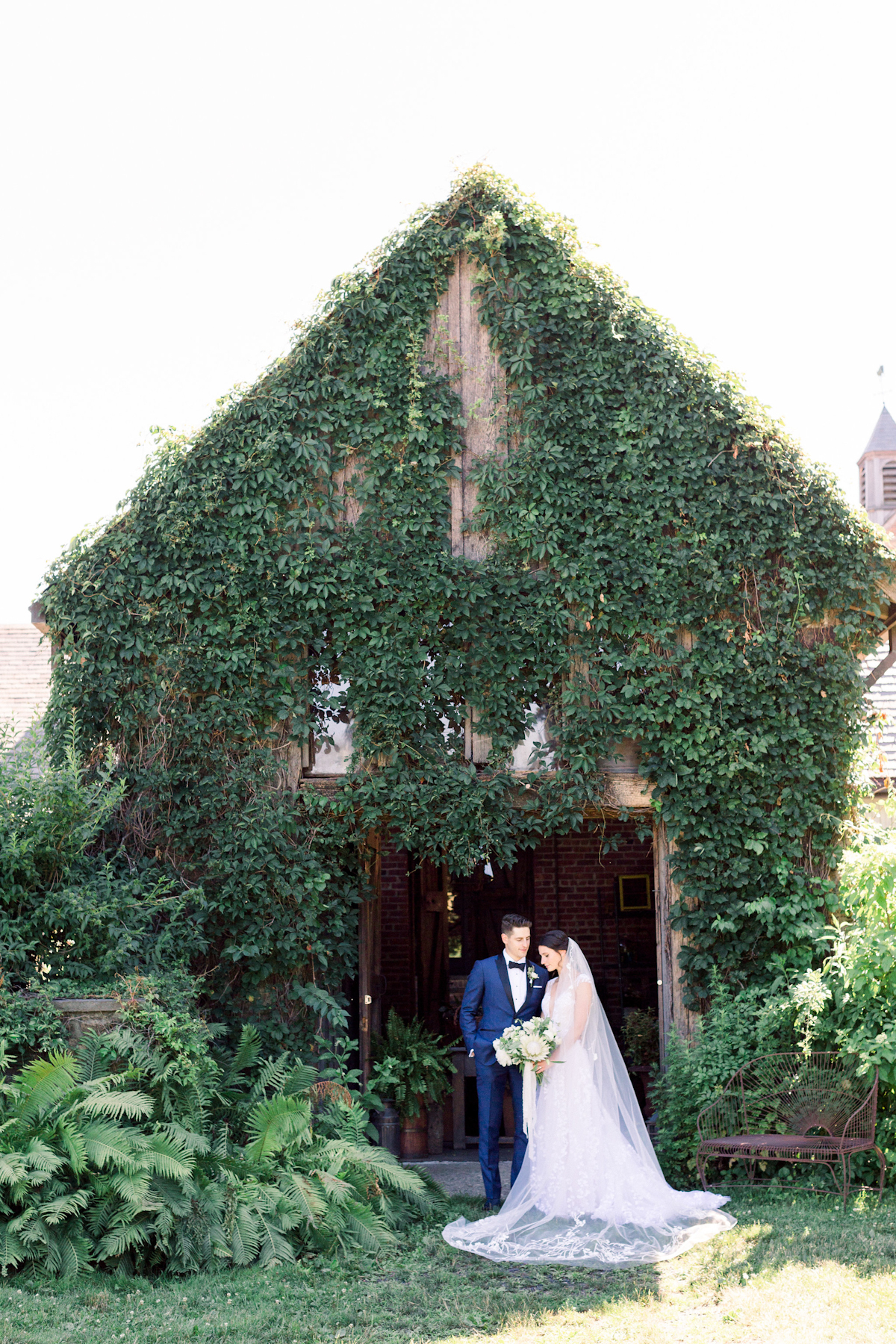 Bride and groom in front of ivy covered shed at Blue Hill at Stone Barns wedding