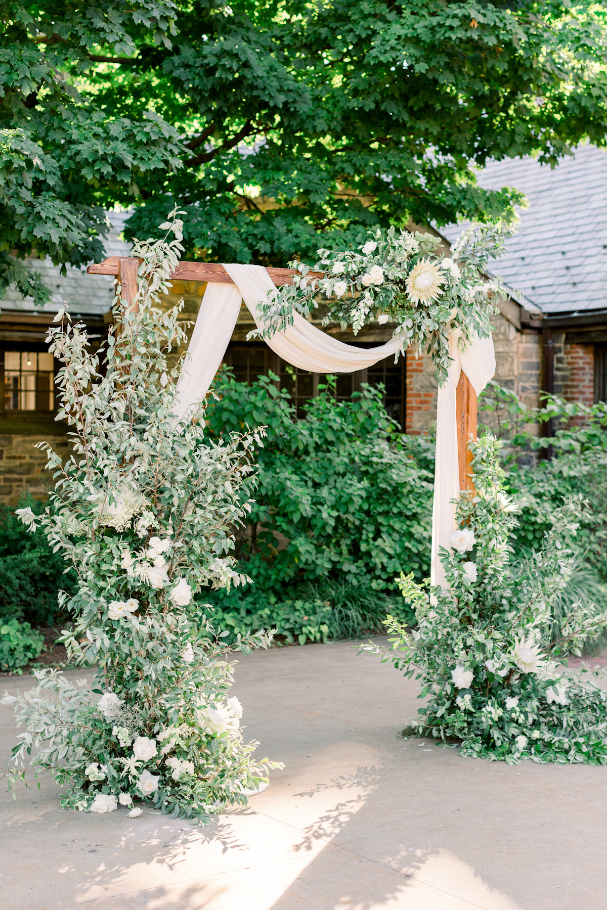 Floral arch with protea at Blue Hill at Stone Barns wedding