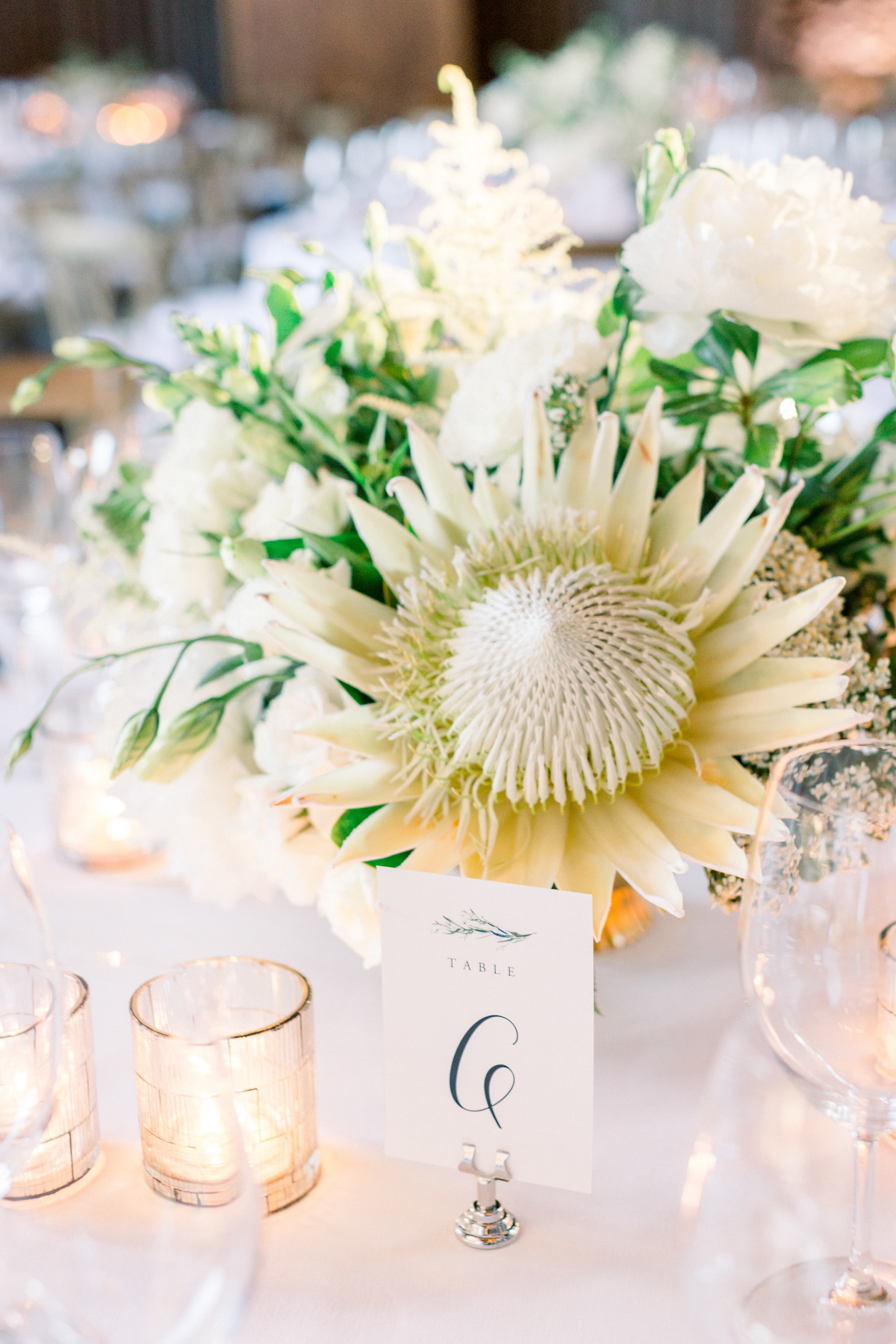 Blue Hill at Stone Barns wedding table number sign and white protea floral centerpiece