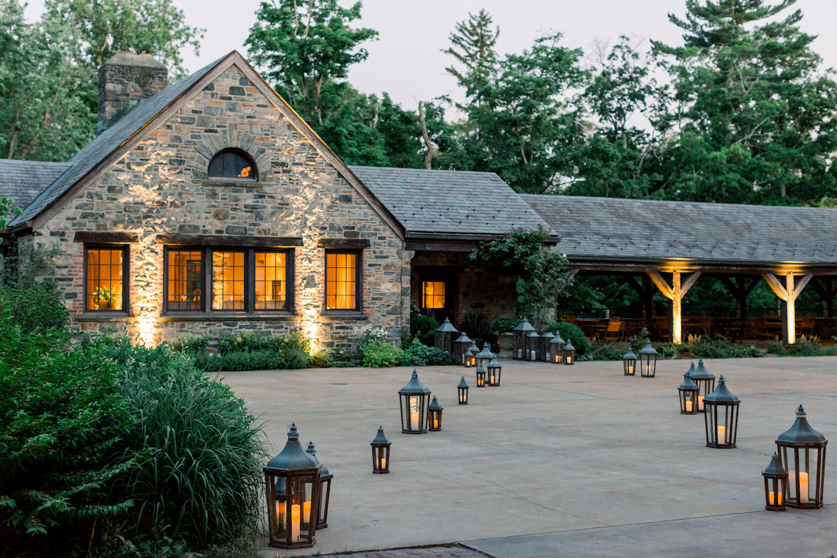 Blue Hill at Stone Barns courtyard with pathway lined by lanterns