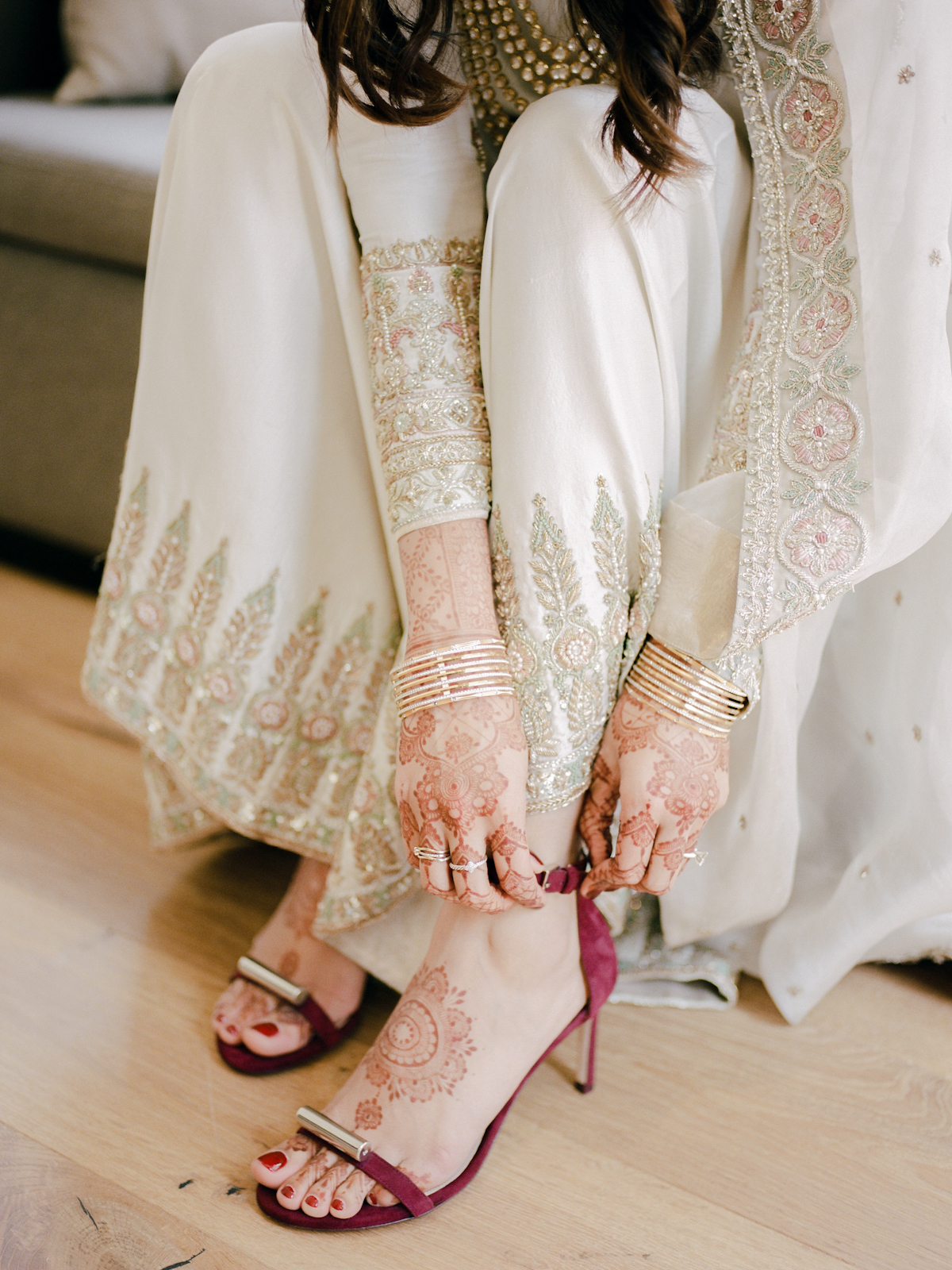 Bride putting on her wedding shoes for Rainbow Room wedding