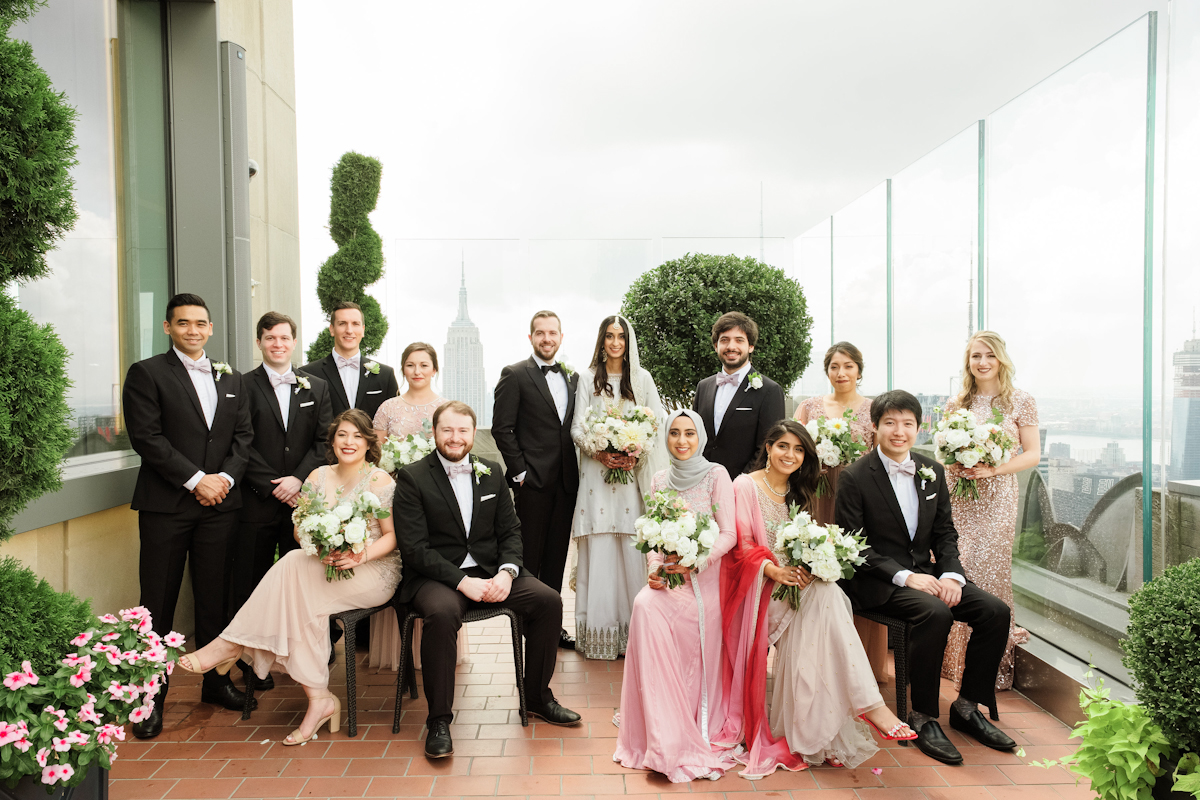 Bridal party at Rainbow Room wedding in pink and champagne colors