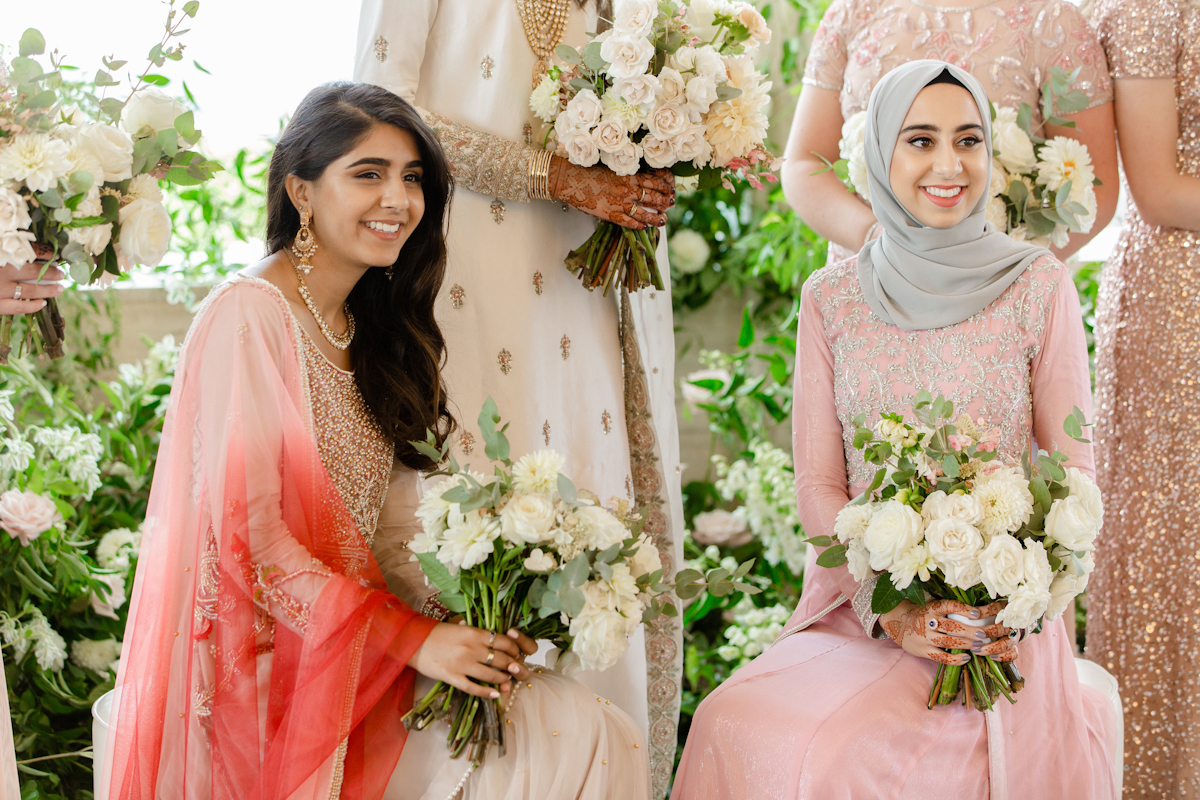 South asian bridesmaids at Rainbow Room wedding holding bouquets