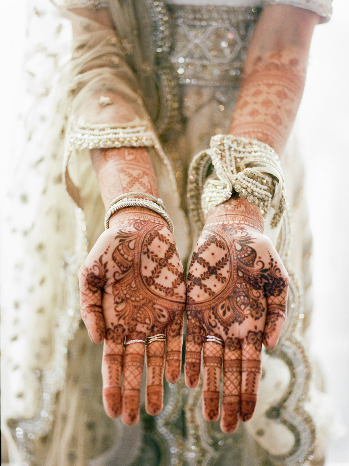 South asian bride with henna art on her hands at Rainbow Room wedding