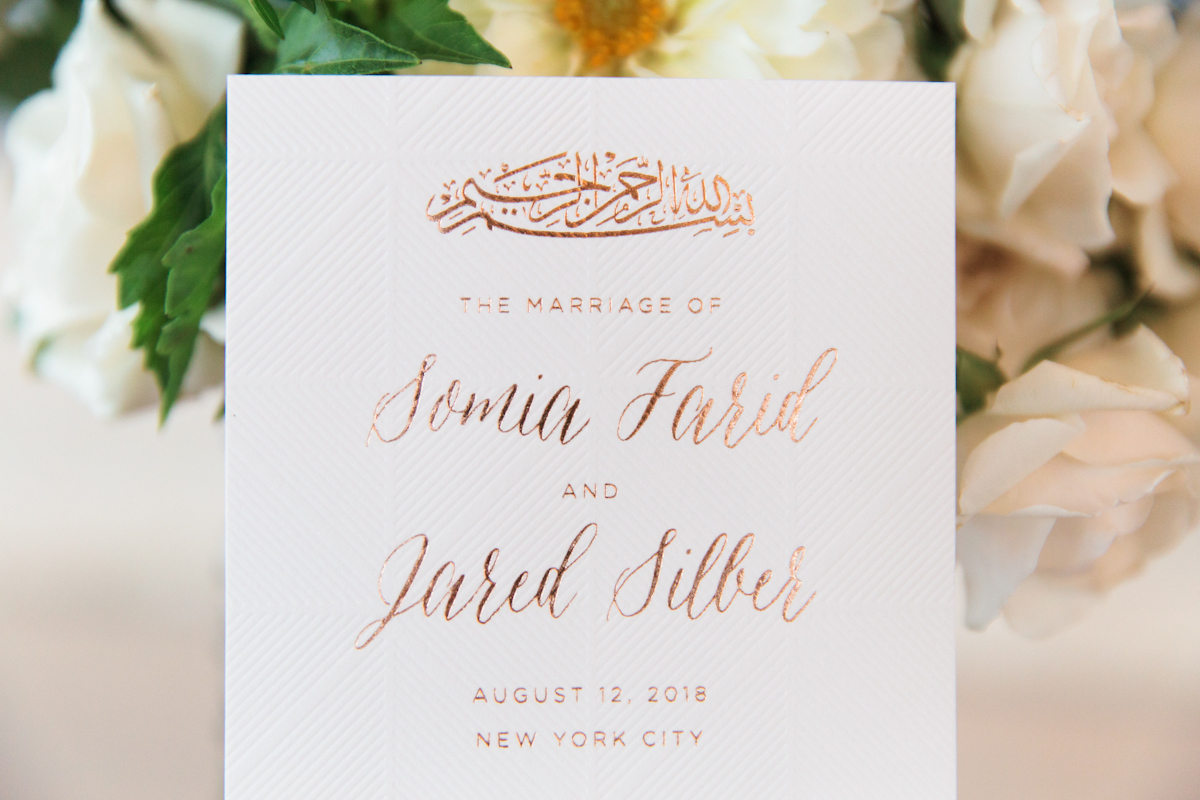 South asian Rainbow Room wedding ceremony program with foil details