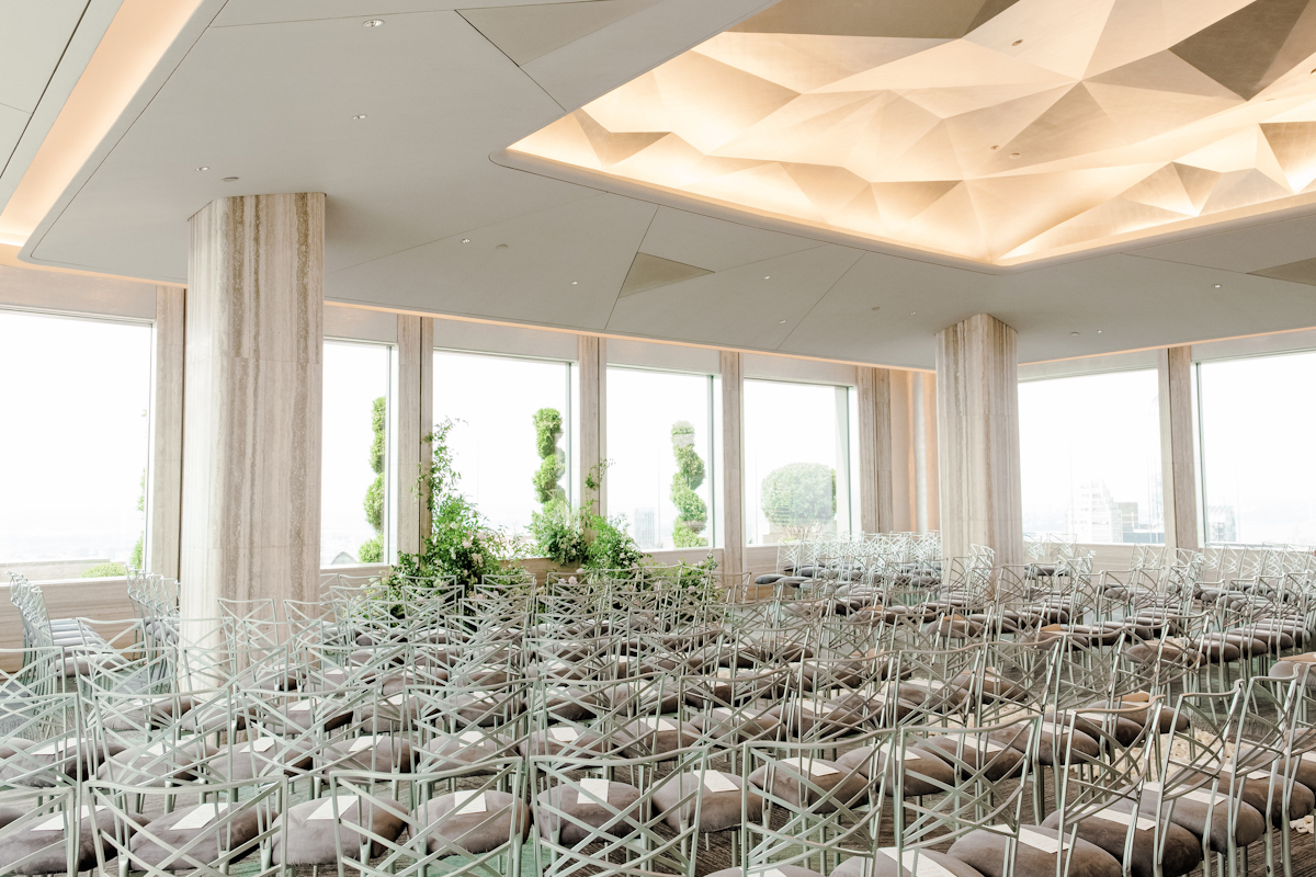 Rainbow Room wedding ceremony chairs and flowers