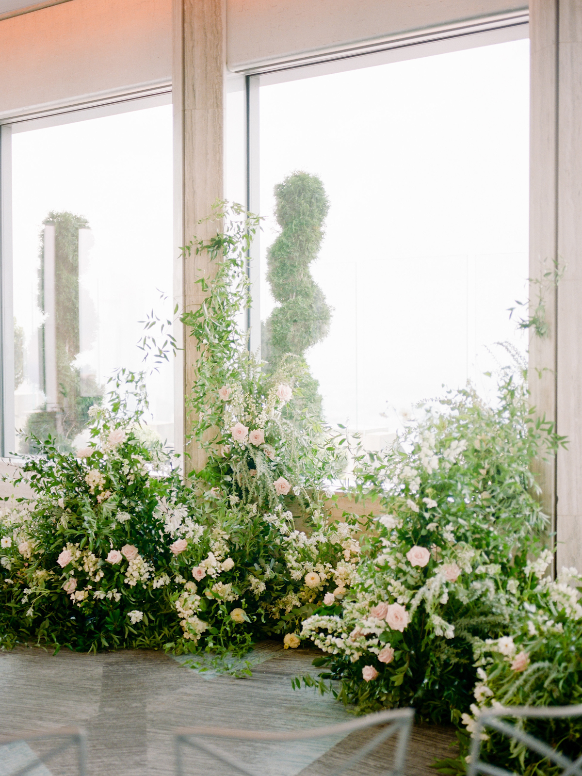 Rainbow Room wedding ceremony with flowers growing up from the ground