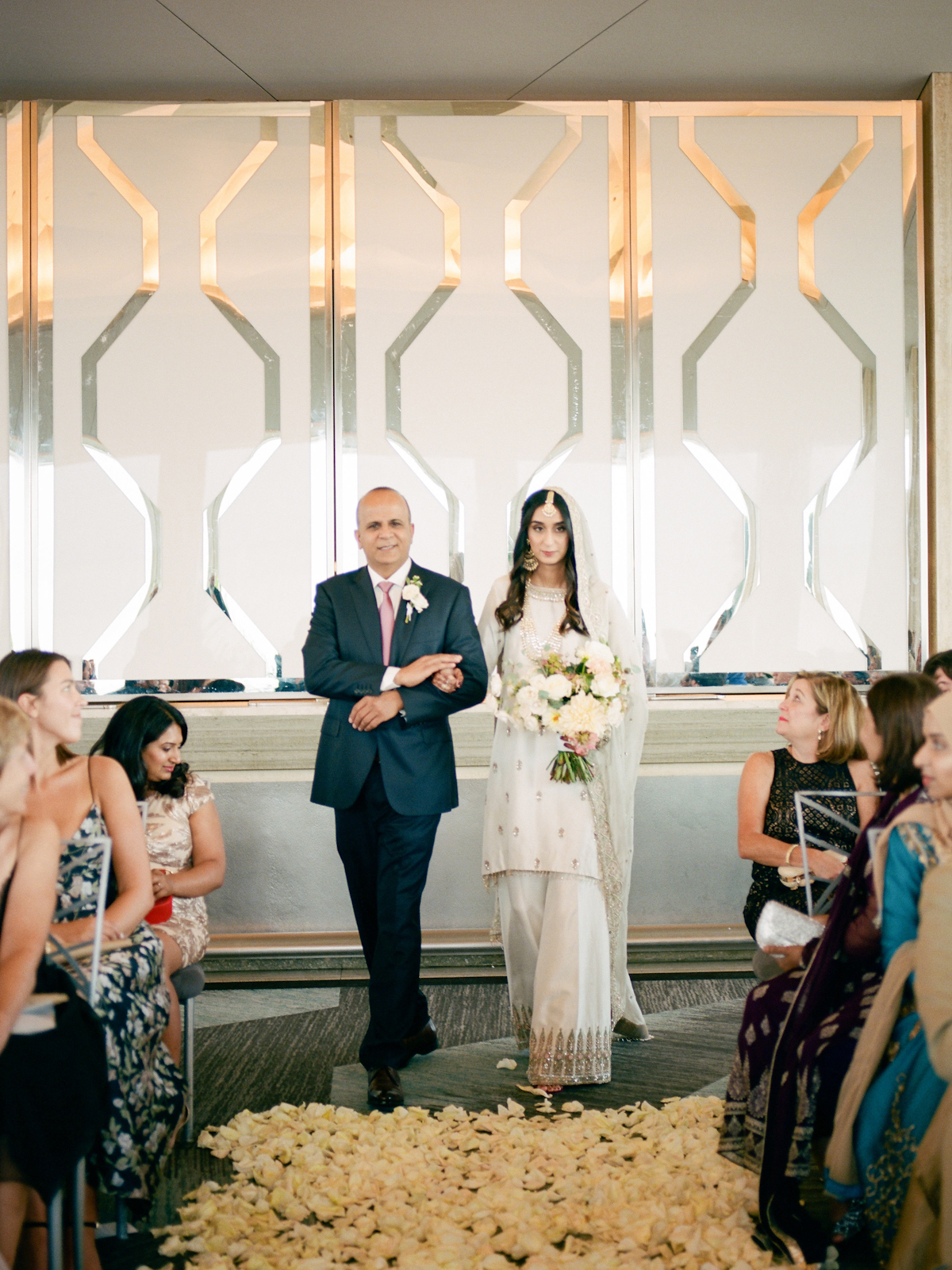 South asian bride walks down the aisle at Rainbow Room wedding