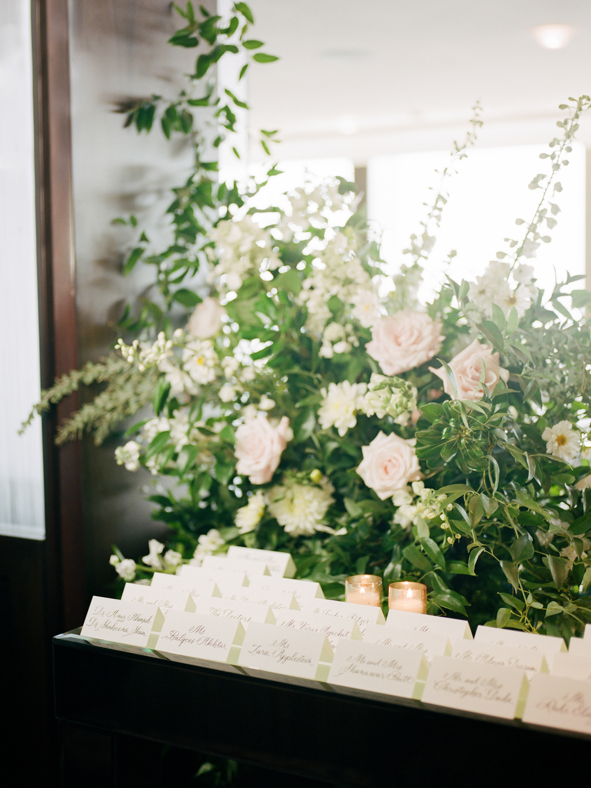 Escort card table flowers and calligraphed cards at Rainbow Room wedding