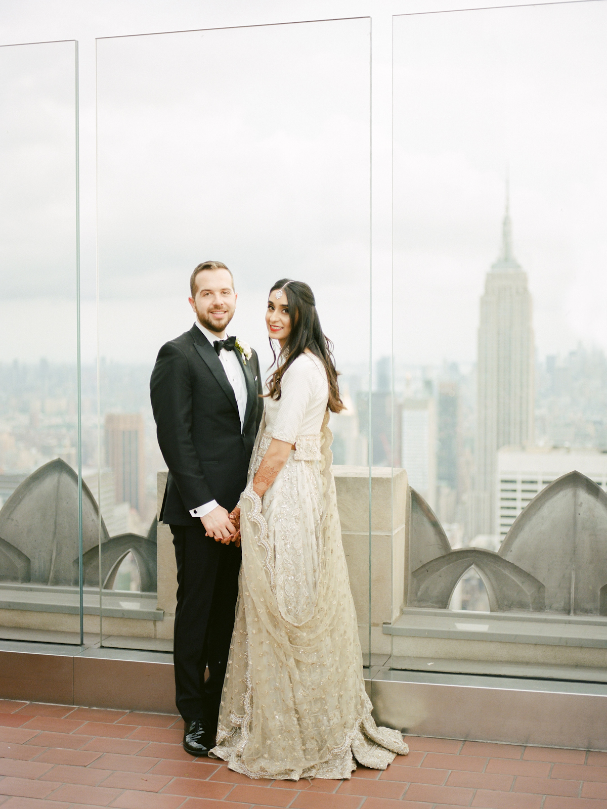 South asian bride and groom in tuxedo at Rainbow Room wedding
