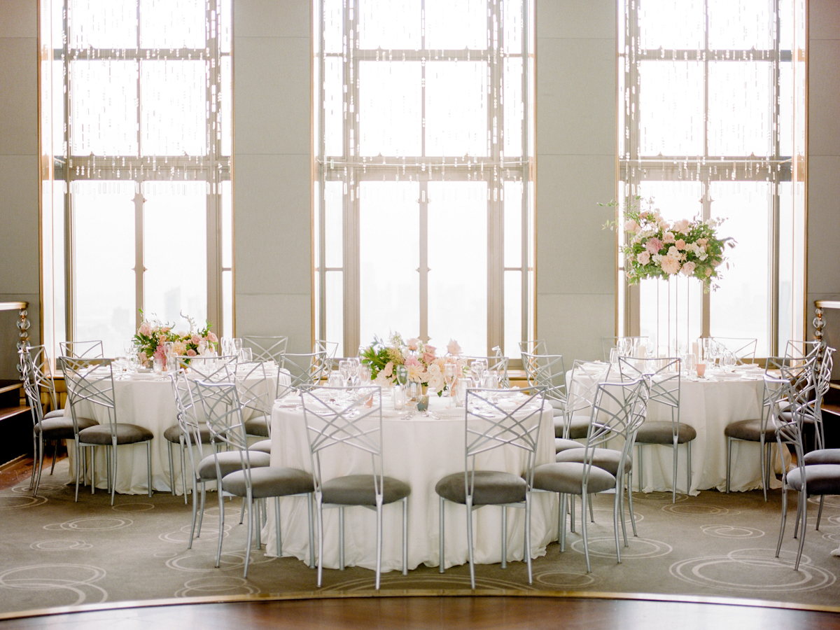 Rainbow Room wedding flowers with tall and low lush centerpieces