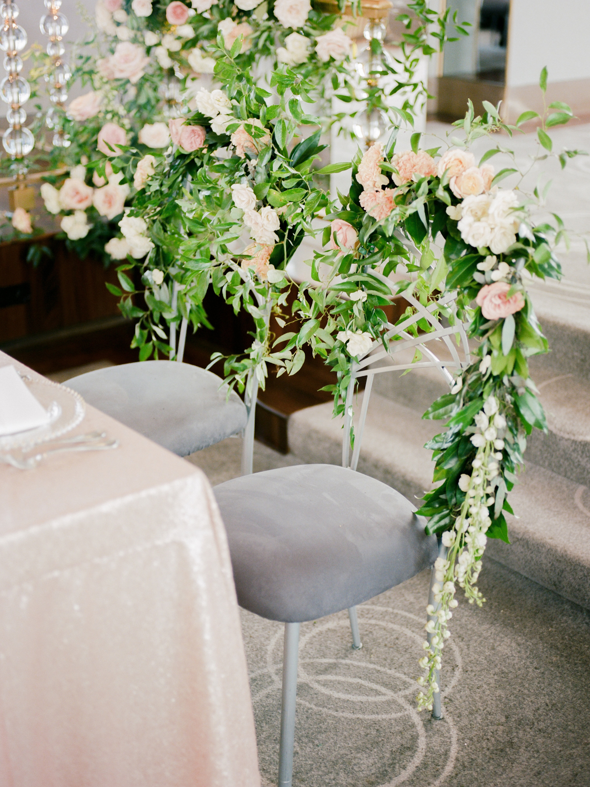 Chairs with floral garlands at Rainbow Room wedding